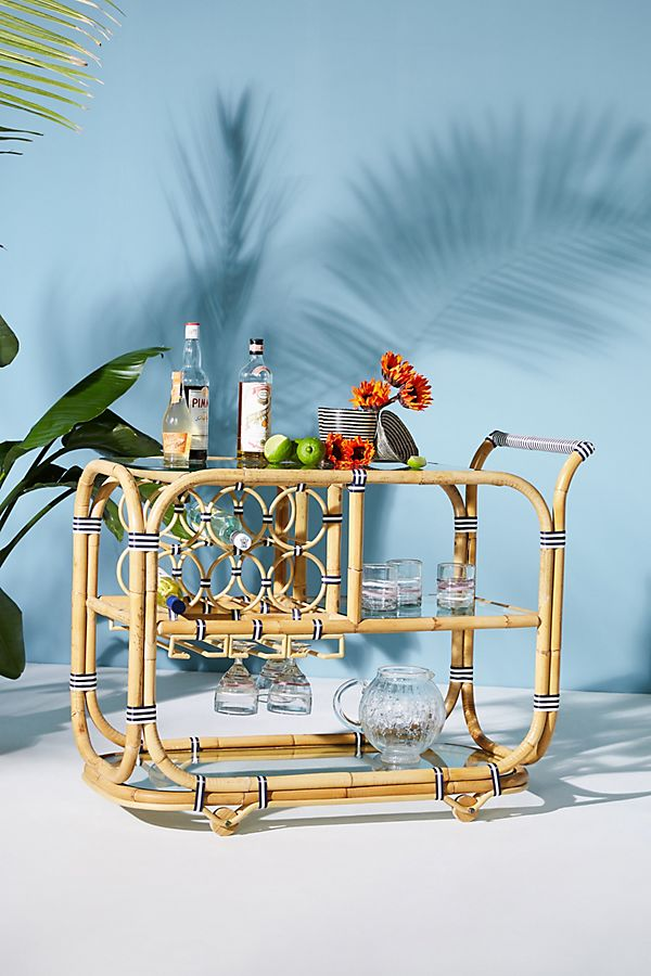 Wrapped Rattan Indoor/Outdoor Bar Cart - You can never go wrong with a bar cart; and that goes for outside as well. Making cocktails on this bar cart is the perfect lemon wedge on top. Source: Anthropologie