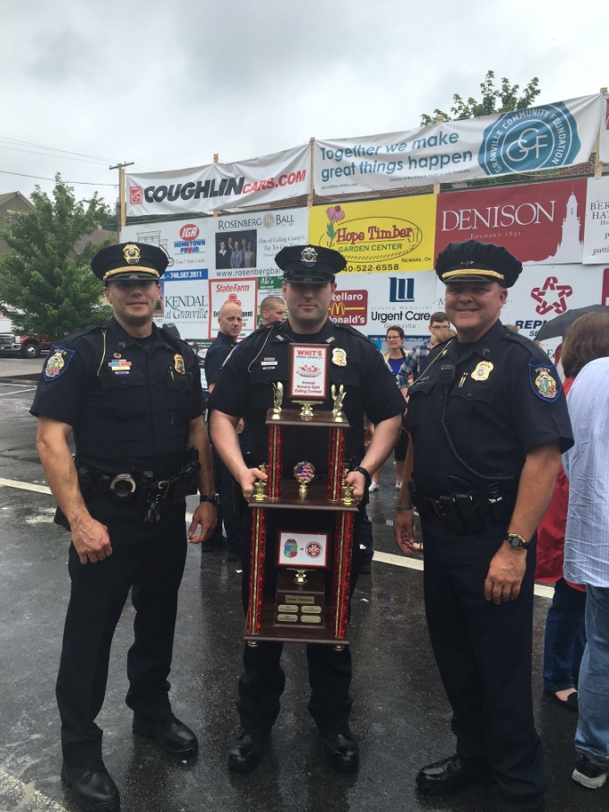 Sergeant Brian Costa, Officer Reese Southard, and Sergeant Chuck Marcum. This picture was taken shortly after their victory, and while the FD personnel in the background were still in the process of adjusting to the shame of their loss.