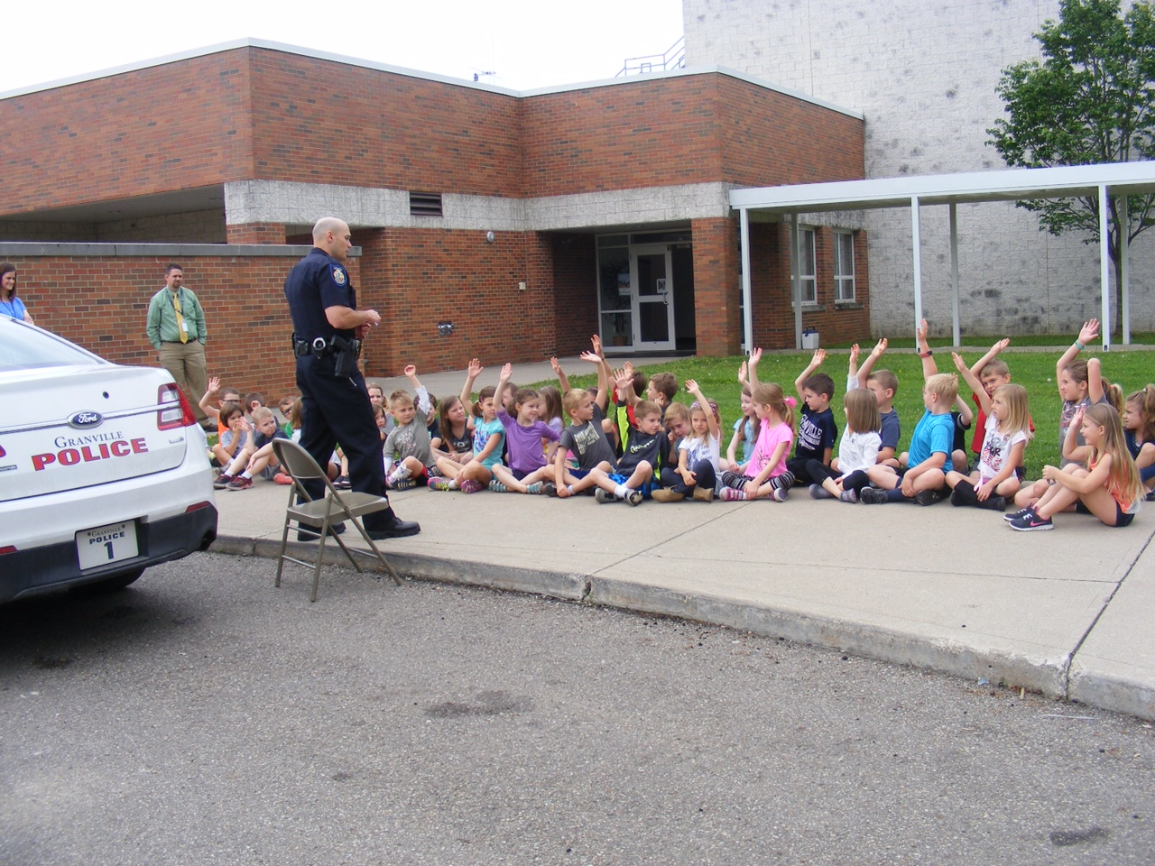 Sergeant Brian Costa gives a safety talk to students from the elementary school.