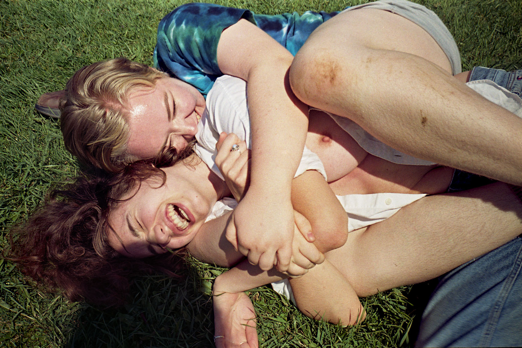Ruby and Karlyn in the grass, 2018.    © Cameron Schiller