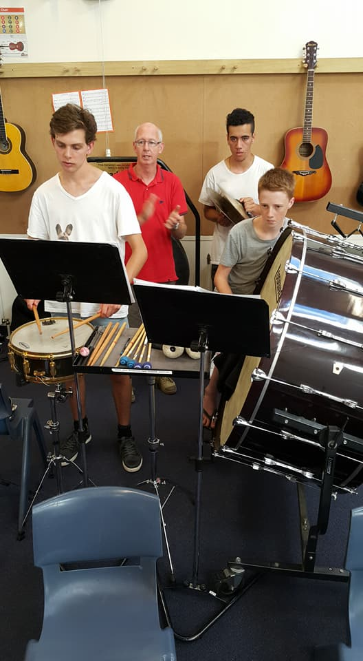 Grant Myhill working with the Percussion section