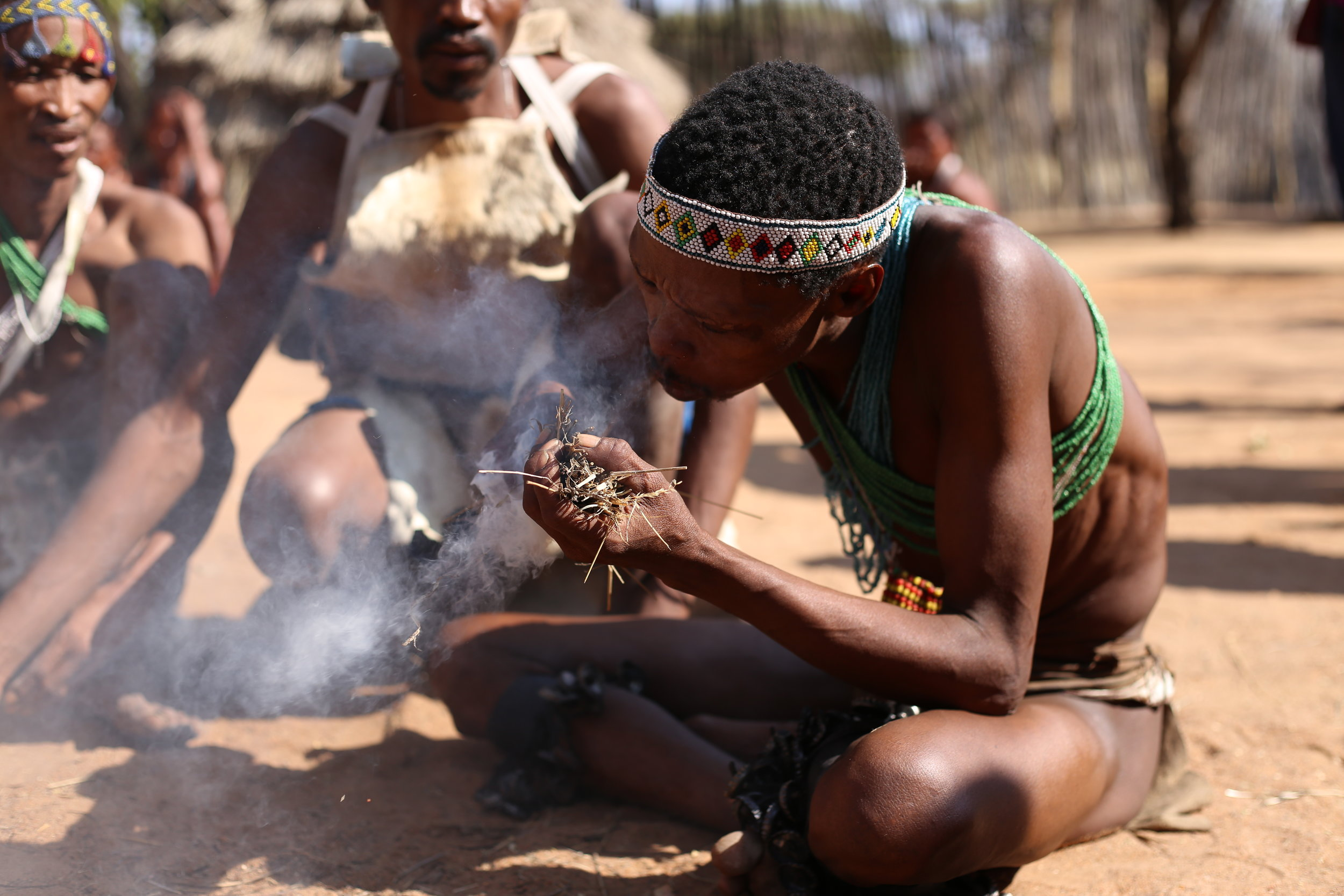 Building a traditional bushmen fire.