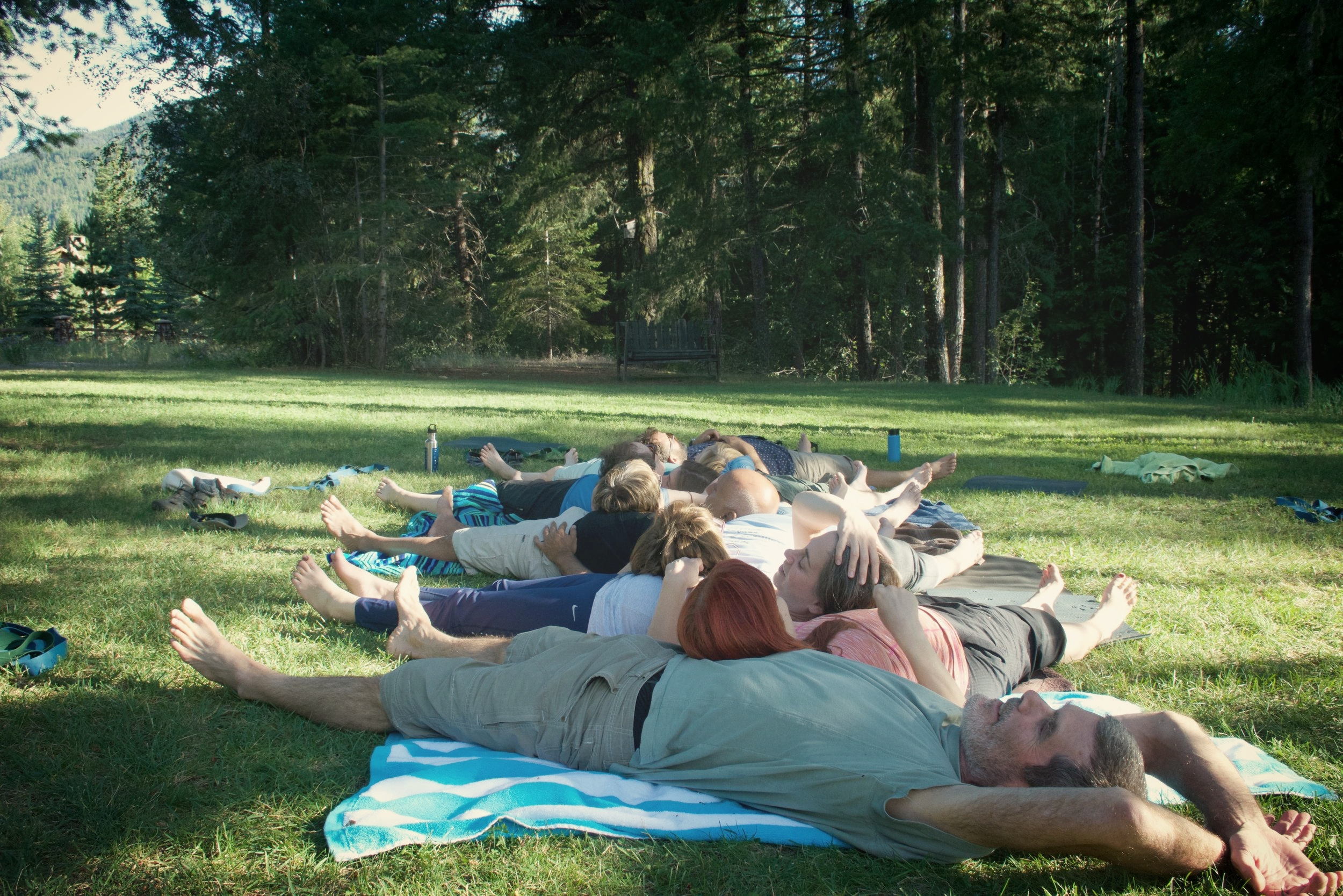 Group savasana outside during our last retreat in Mazama!