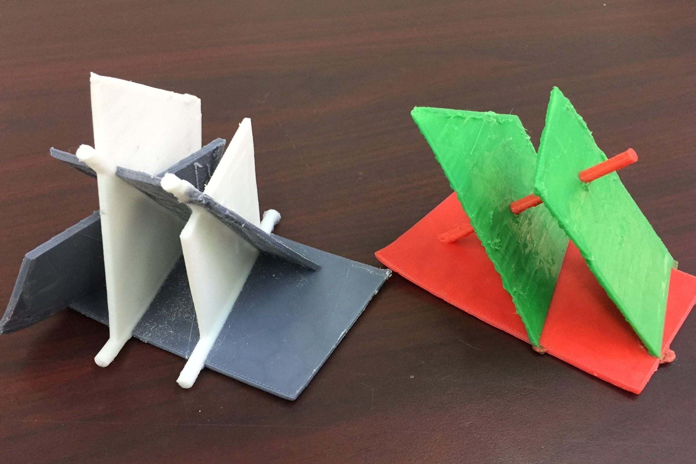 Intersections of parallel planes and two planes perpendicular to the same line. The model on the left was filed down. The one on the right has not been filed yet.