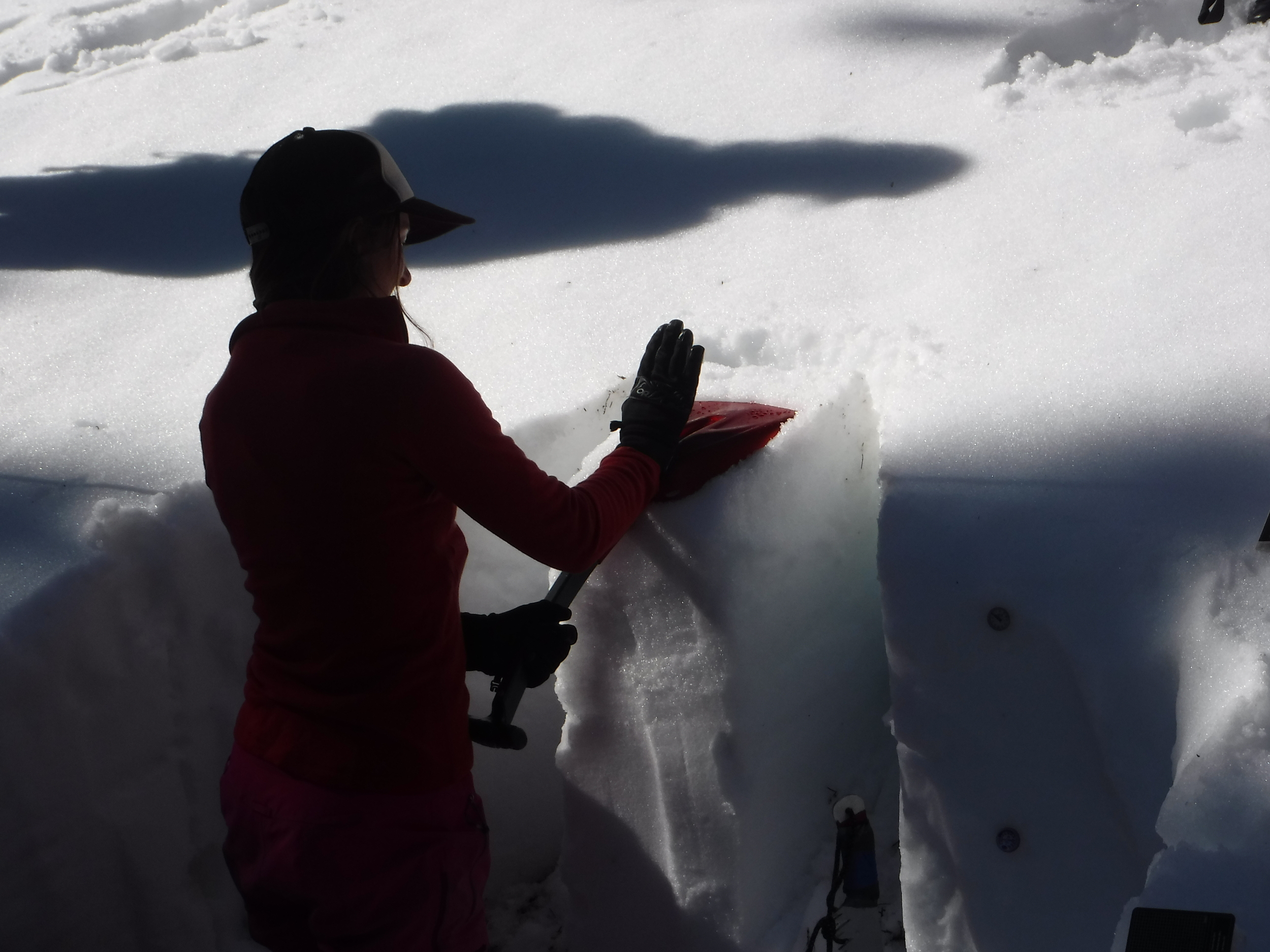 Annah demonstrating how to properly test the snow.
