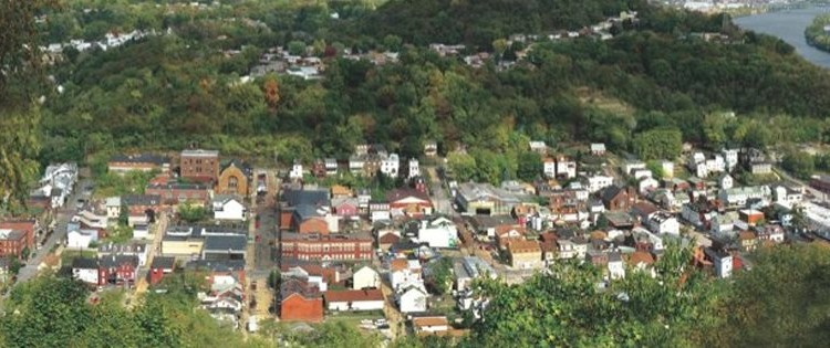 Millvale nestled in the valley, with the Allegheny running to the south. Photo courtesy of Millvale Borough.