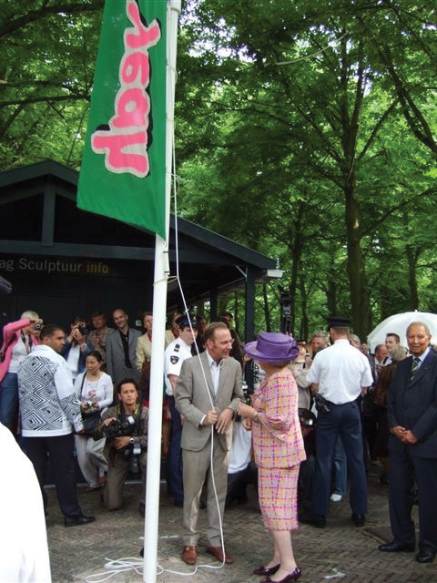 Queen Beatrix of the Netherlands raises the 'yeah' flag as part of the exhibition, DeOverkant Downunder.