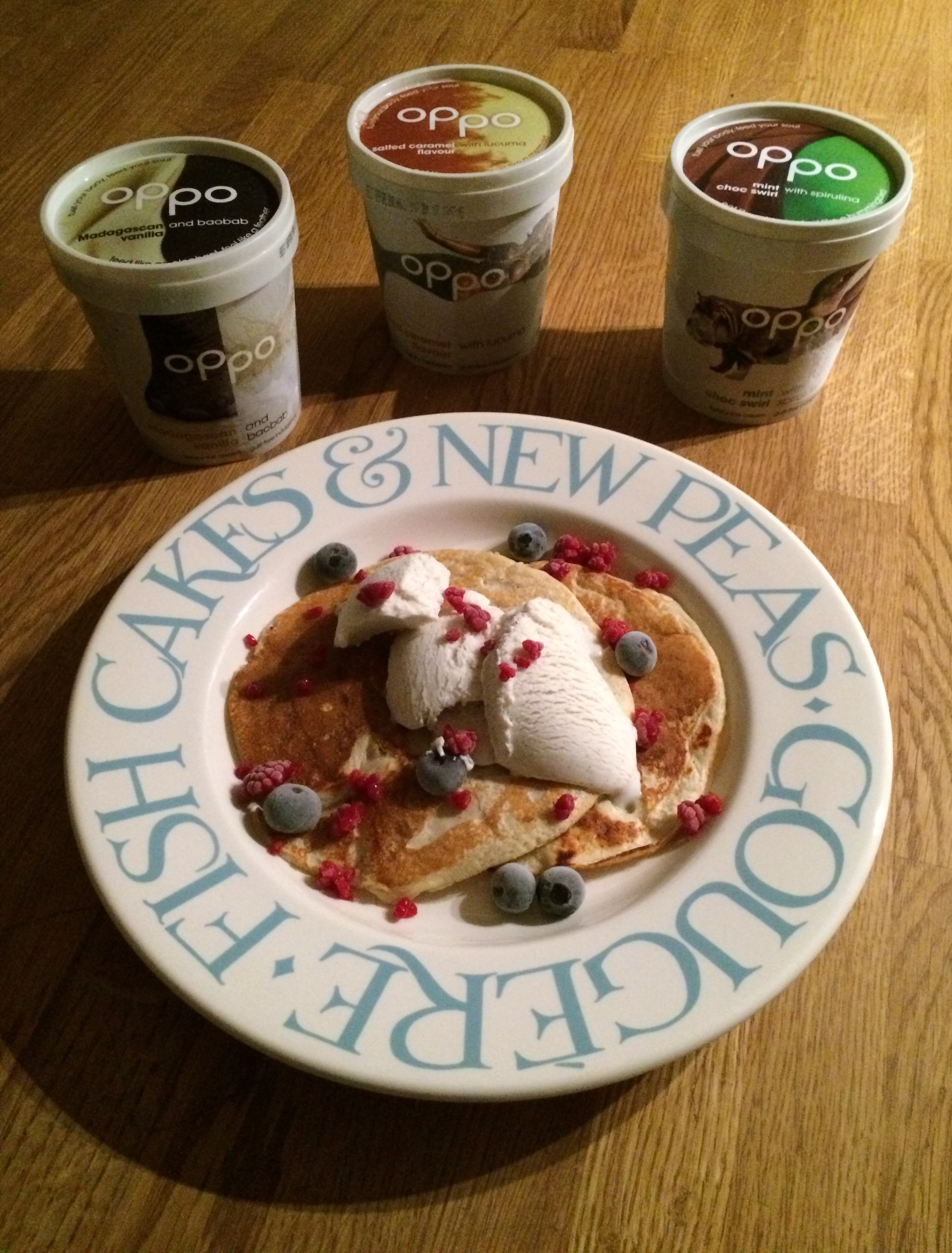 Protein pancakes topped with frozen raspberries, frozen blueberries and Madagascan vanilla and baobab Oppo ice-cream