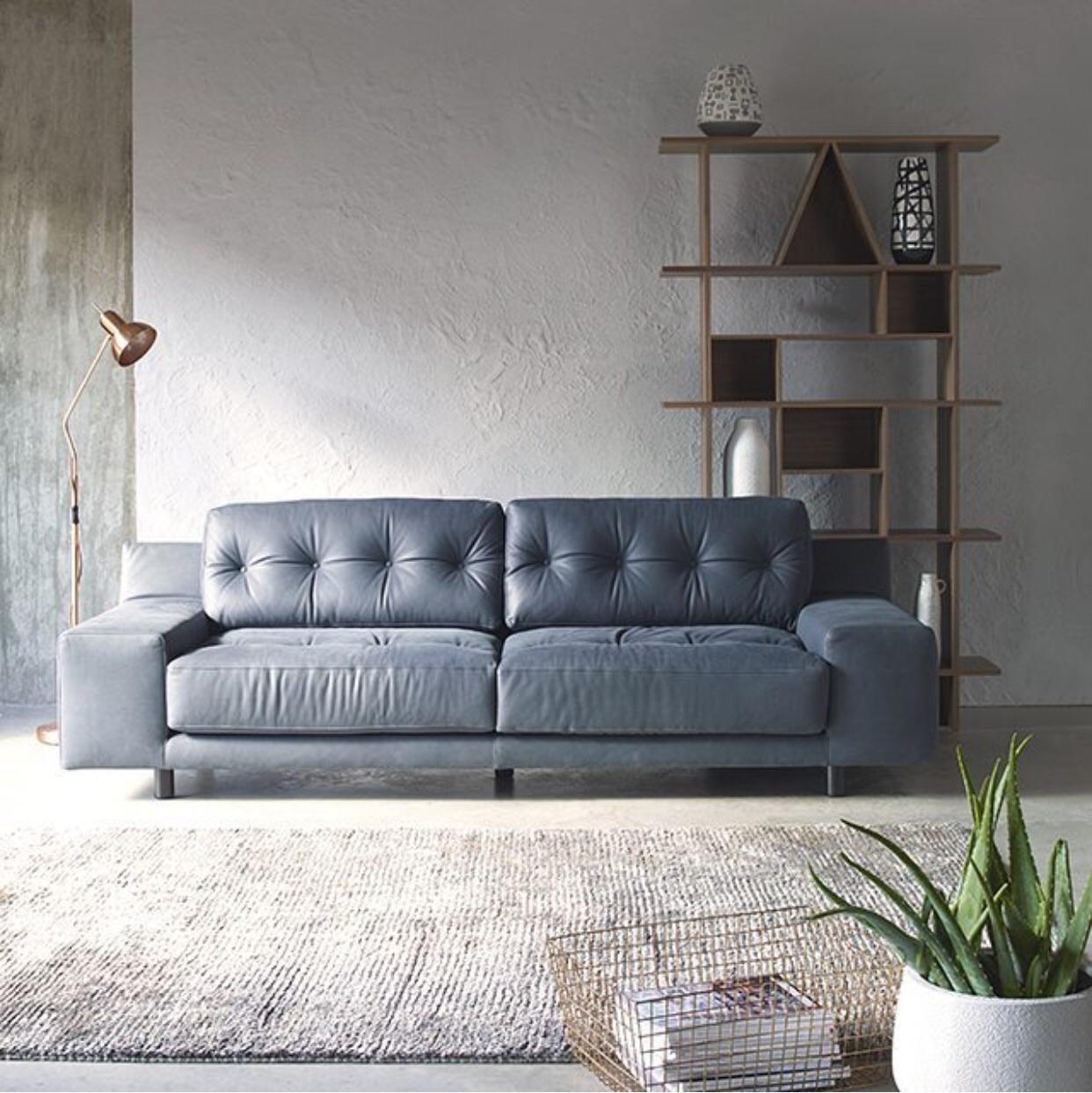 Habitat has this really special three seater settee the Hendricks sofa    http://www.habitat.co.uk/hendricks-charcoal-fabric-3-seater-sofa-289842