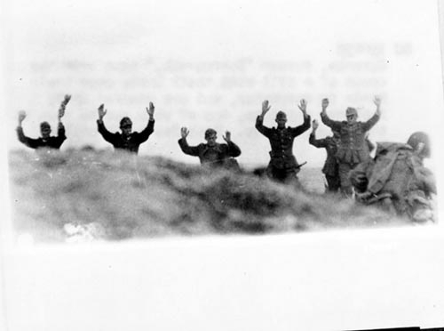 Photo by  The U.S. Army : German troops surrender to Soldiers during the Allied Invasion of Europe, D-Day, June 6, 1944.  www.army.mil/d-day