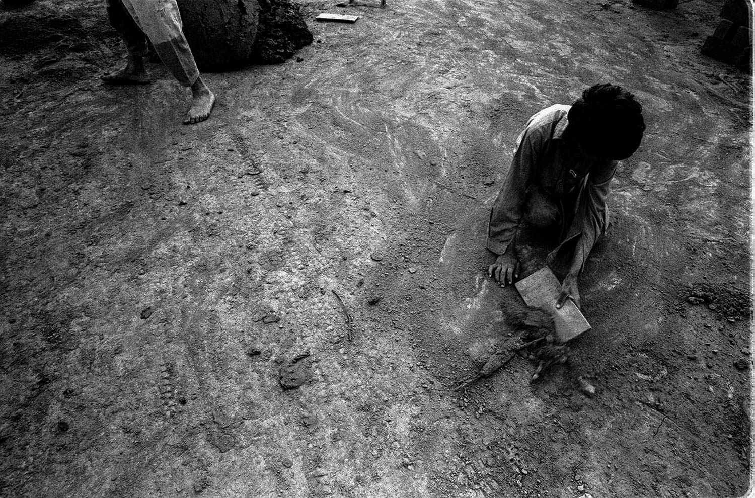 For thousands of Afghan refugees, the exodus from their country, towards a better condition of living, turned to be just the beginning of a new struggle for life.Without any money, without job, and strangers in a hostile Pakistan, the afghan families had no other choice than labouring thirteen hours a day in the bricks factories spread all over the country.One family, two thousand seven hundred bricks to be produced by hand every day.A poor salary as a meagre consolation   of their efforts, just enough to survive, serious diseases caused from the lack of hygiene, and kids from just the age of three years old starting a life without hope, forced to labour together with their parents to reach the daily target; thousands of heavy bricks.Stolen childhood is called, stolen childhood I have witnessed.