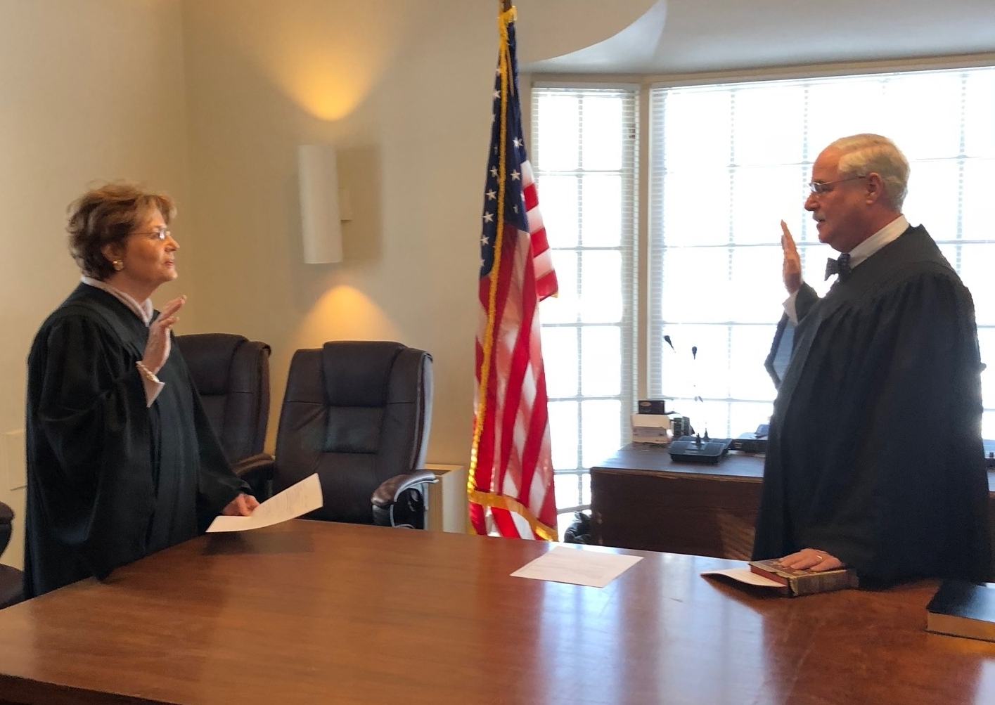 Town Justice Regina Kelly swears in reelected incumbent Town Justice Ira Clair.