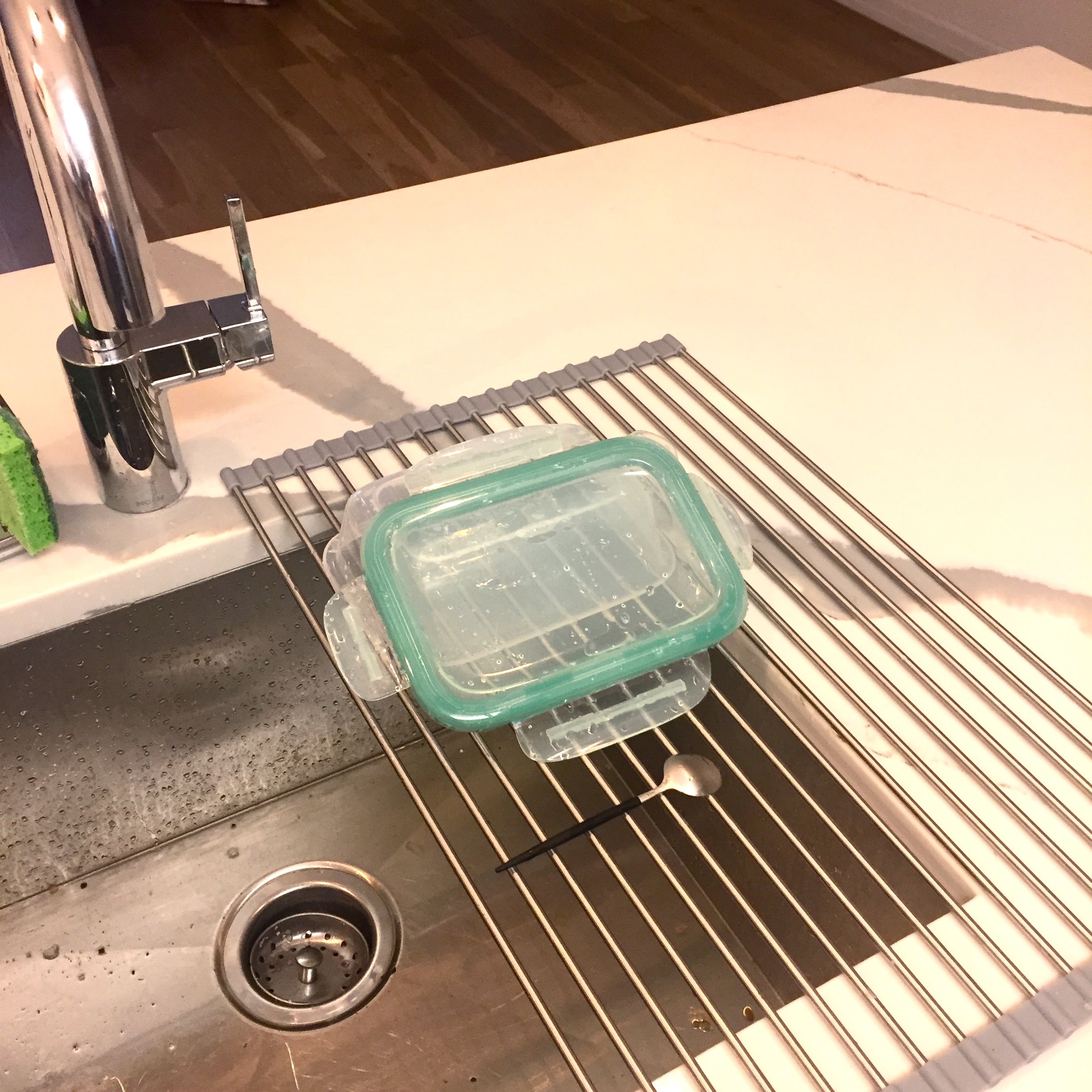 The Magical Dish Drying Rack - There are few things worse than a drying rack taking up all of your counter space (right??). This guy sits over the sink, can be rolled up and put away, and is super attractive! I'm sweating from excitement.