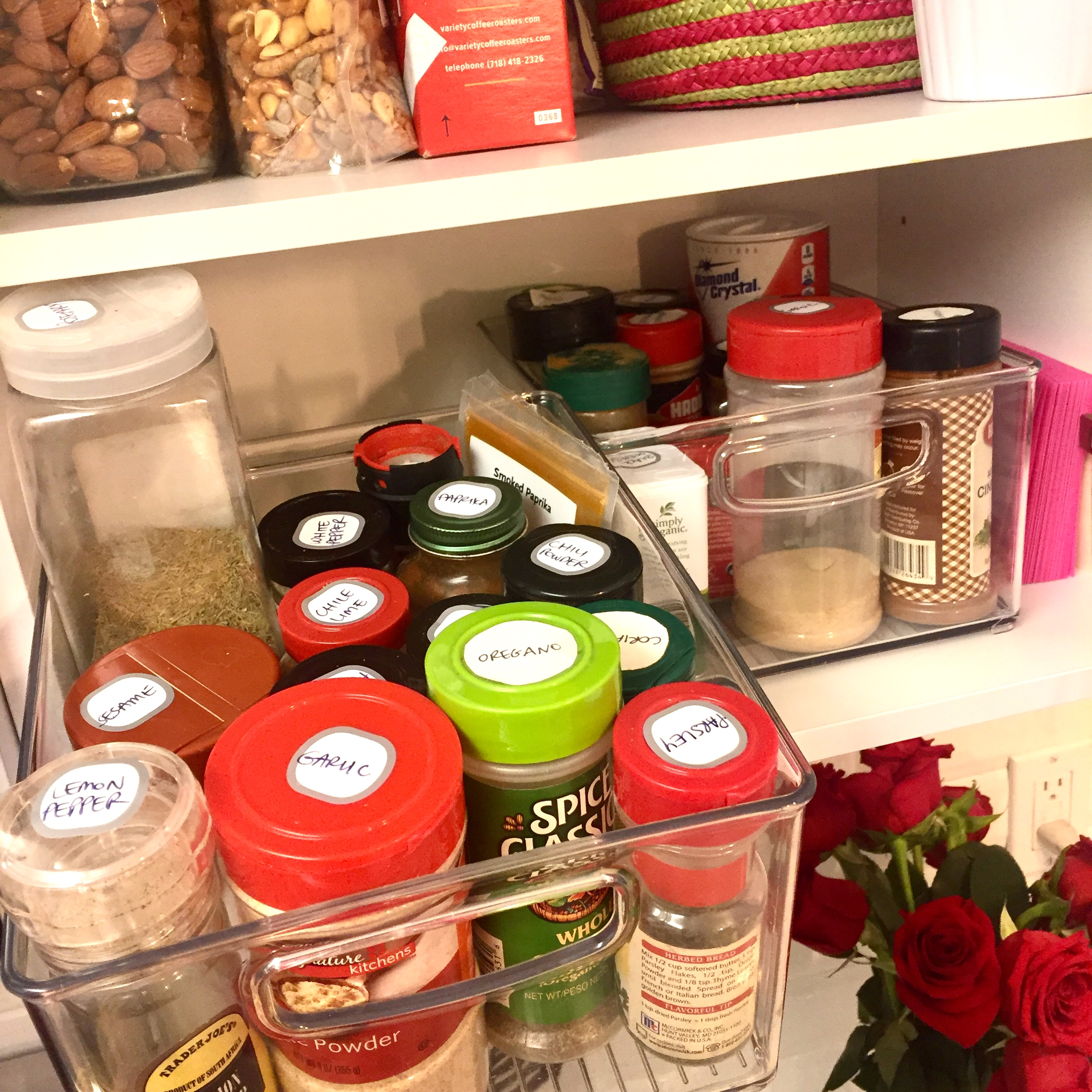 Binzzzzzzz - If you've gotta store your spices on a shelf, putting them in a bin and labeling the tops is a fantastic solution to the search for the spice you need. Pull out the entire bin and grab what you need before your saucey concoction starts to burn on the stove. Heck, add bins wherever you need to contain like-ingredients (baking goods, for example).