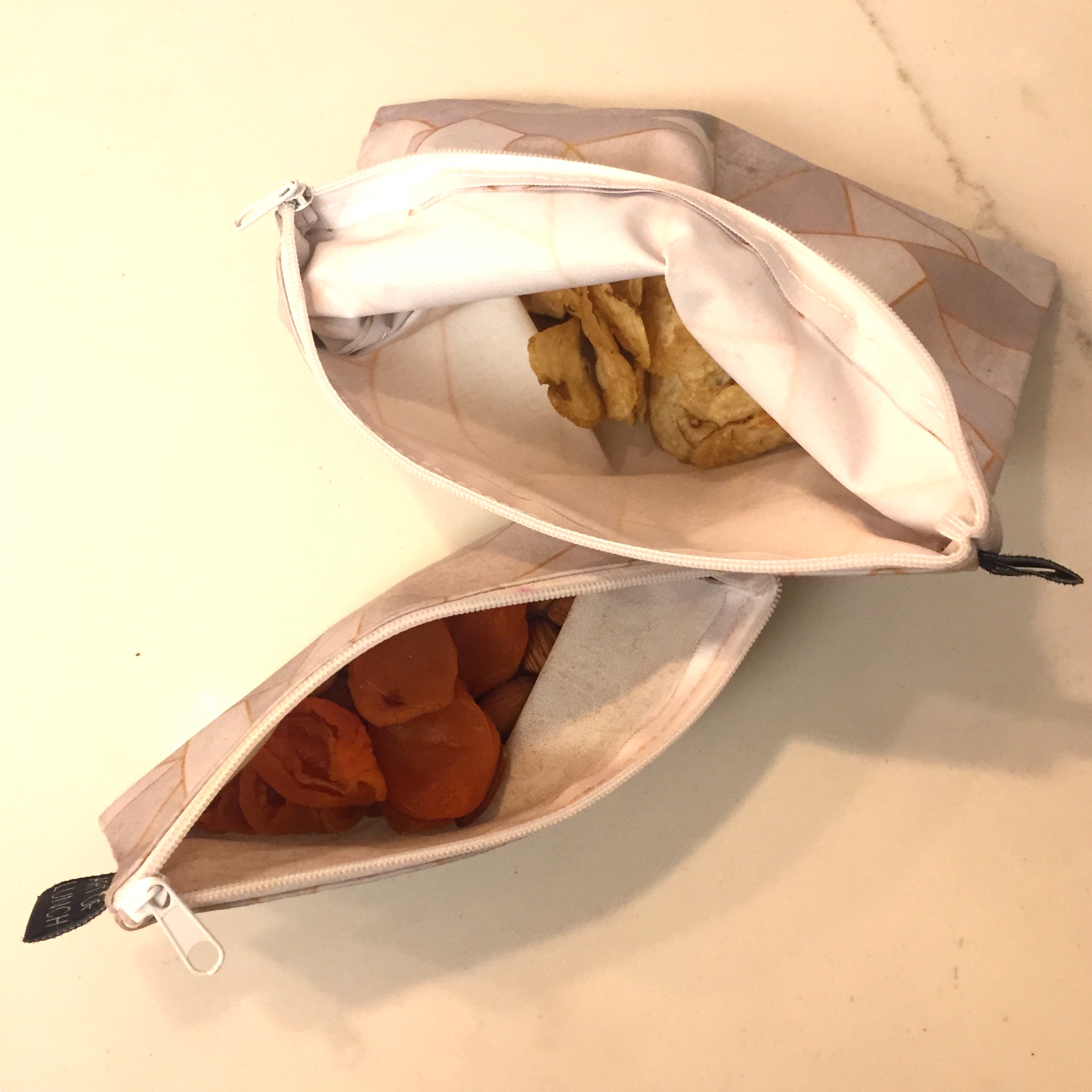 Reusable Snack Bags - These are the ABSOLUTE BEST and I never leave home without mine. One is for nuts and dried fruit and the other is for bigger snacks (like popcorn, pretzels or chips). They're washable and can literally be used for years and years. Granda Tidy Tova will be using these, no doubt.