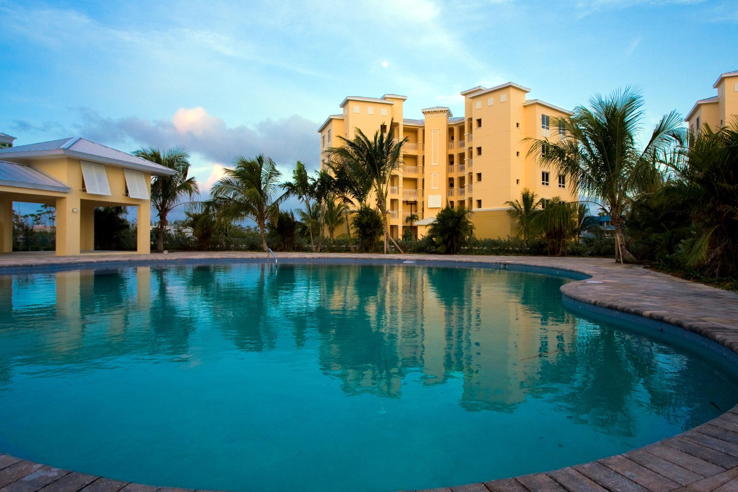 Suffolk Court Bahamas exterior pool dusk.jpg
