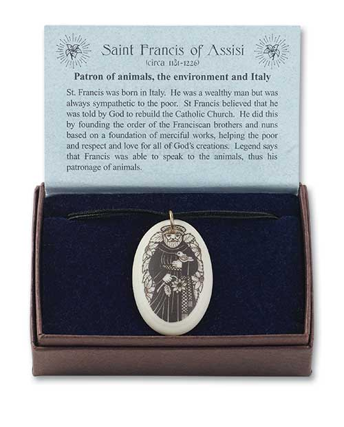 Our Patron Saints line of porcelain jewelry comes packaged in a velvet-lined box (shown above), or on a hang card (shown below) with a card describing the meaning of each design and it's religious symbolism