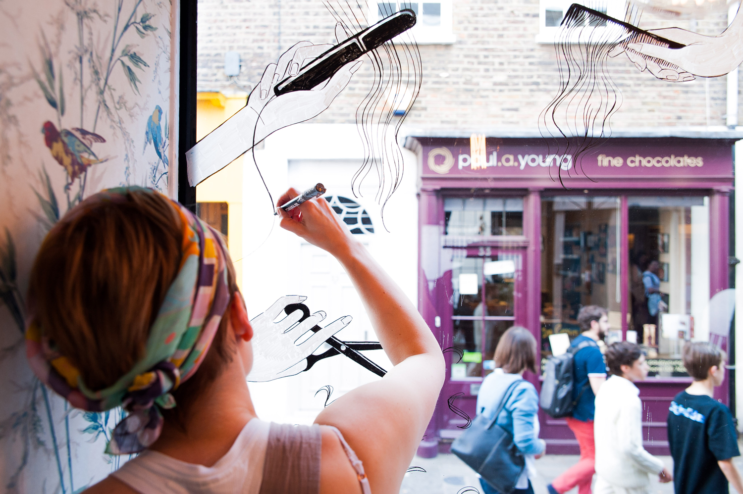 Live painting, illustrated windows and window displays
