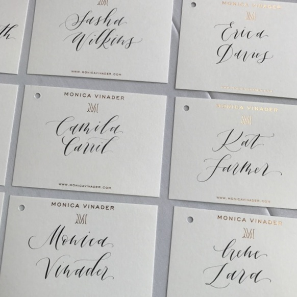 Imogen Owen's calligraphy - Hand written place settings for Monica Vinader's Barbican dinner event.
