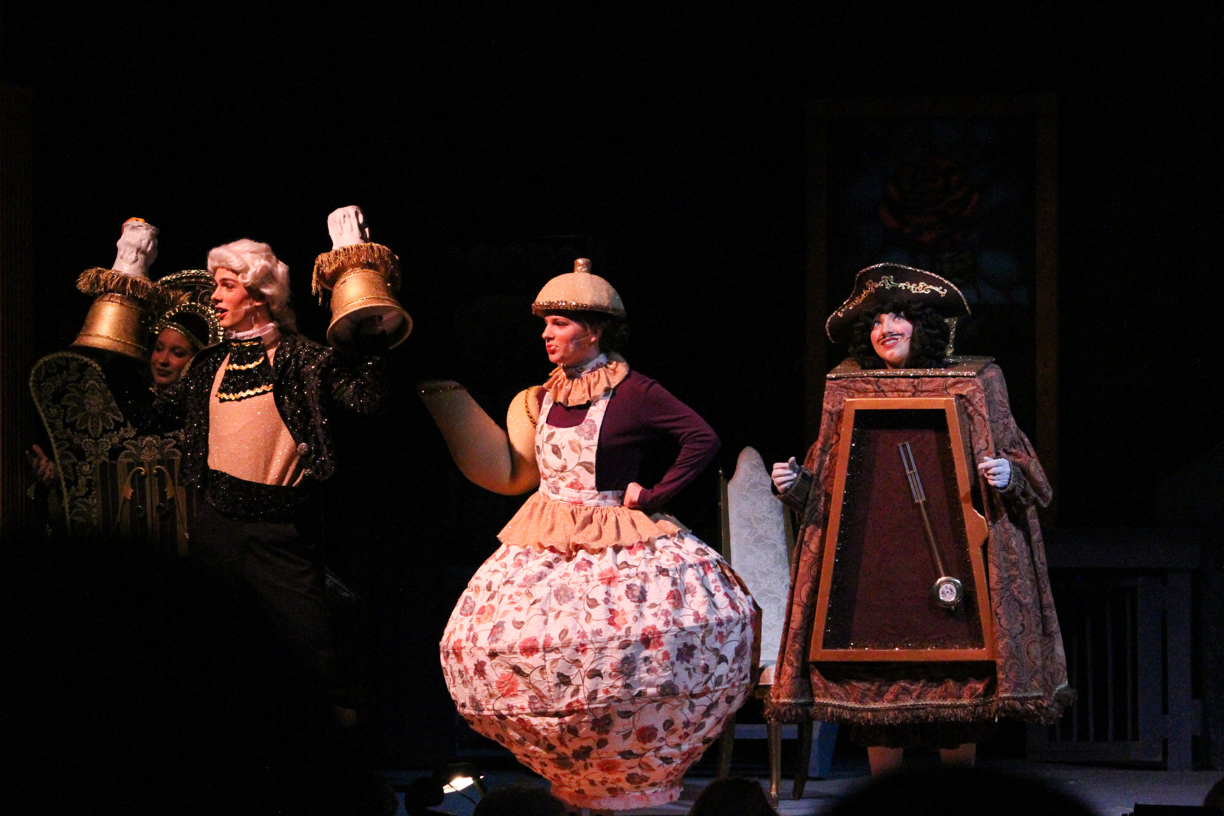 Lumiere the candlestick ( Samuel Lander, senior ), Mrs. Potts the teapot ( Madeline Keenan, Senior ) and Cogsworth the clock ( Tanner Fell, senior ) reminisce what it was like to be human, since being transformed over ten years ago. The costumes were graciously donated with the help of Lander's grandparents.