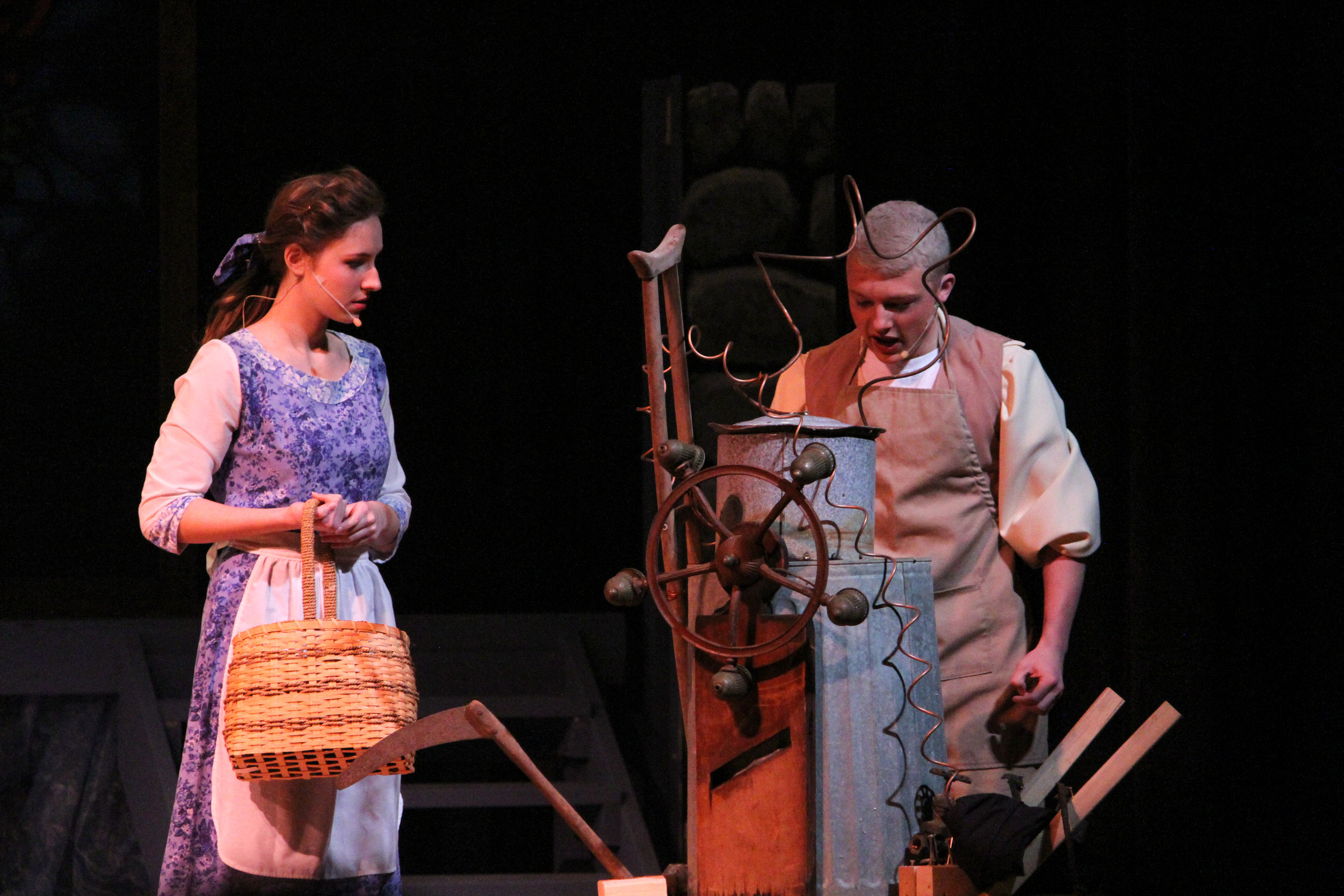 Belle ( Emily Powell, senior ) and her father Maurice ( Harrison Keenan, senior ) discuss the contraption Maurice is building before he heads out to a fair to present his work, on his way he comes across Beast's castle where inside he meets Lumiere the candlestick Cogsworth the clock, Mrs. Potts the teapot and her son Chip the teacup. The offer him their service; however the Beast discovers and imprisons Maurice.