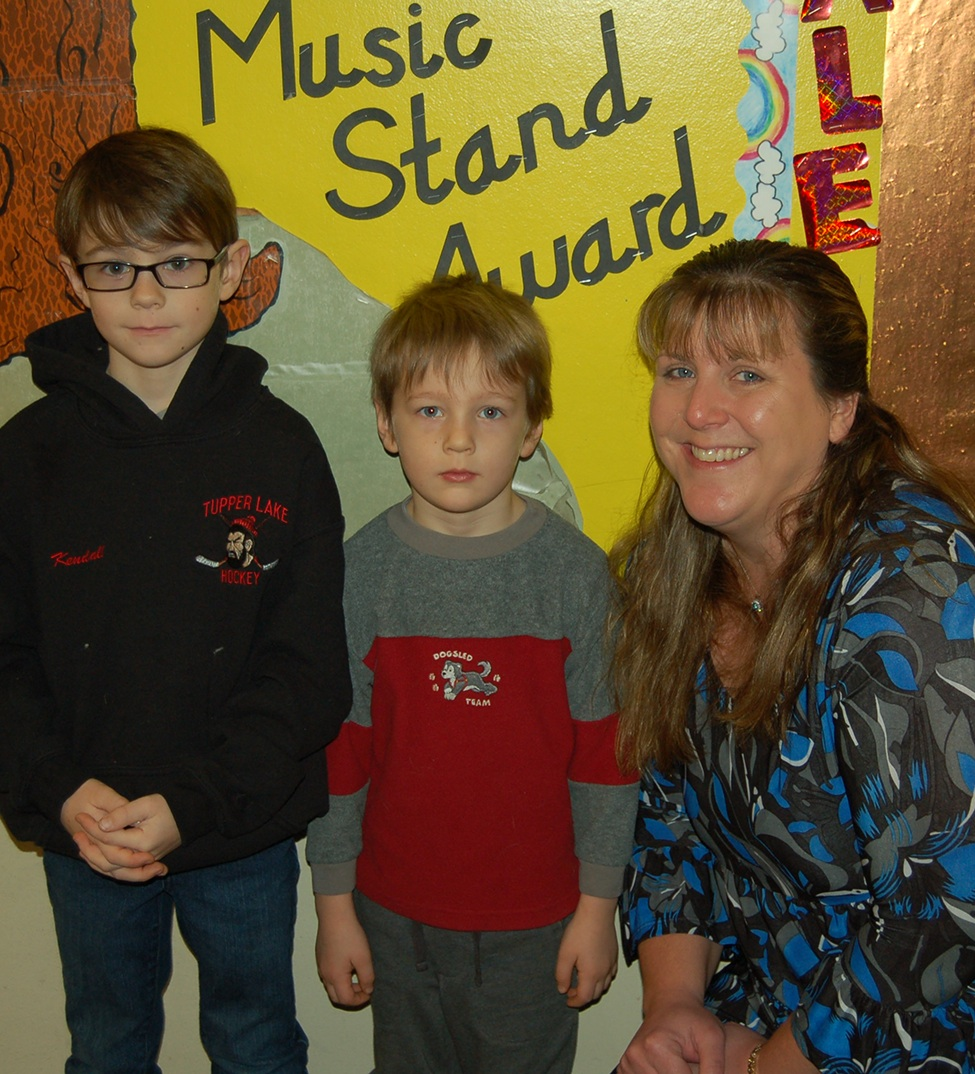Welcome back, kids! New L.P. Quinn Principal Julia Aubrey welcomed two of the first students to arrive back at school Tuesday after the holiday break. With the new principal, who replaced retiring Principal Carolyn Merrihew in September, were third grader Jonah Kendall (left) and his younger brother, Ira, who is a kindergarten student this year. Their mom is fifth grade teacher Michele Kendall. (McClelland photo)