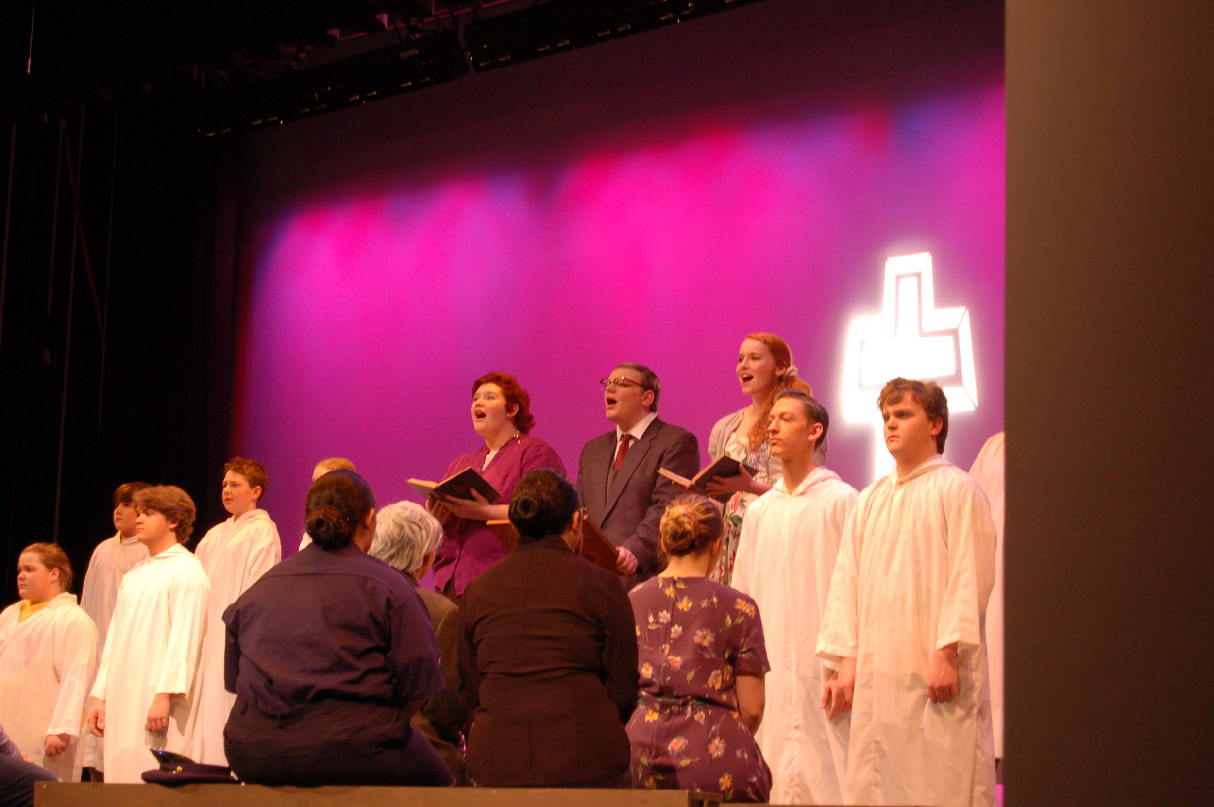 """The alter """"boys"""" from left, Shae Arsenault, Garrett Dewyea, Bryce Davison, Cody Auclair, Jayce Clement and Lowden Pratt.    Faced away, from left, Emily Roberts, Olivia Ellis, Karen Bujold and Caitlynn Flemming. And in mid-song from left, Sadie Johnson, Jonathan McCullouch and Sophia Martin."""
