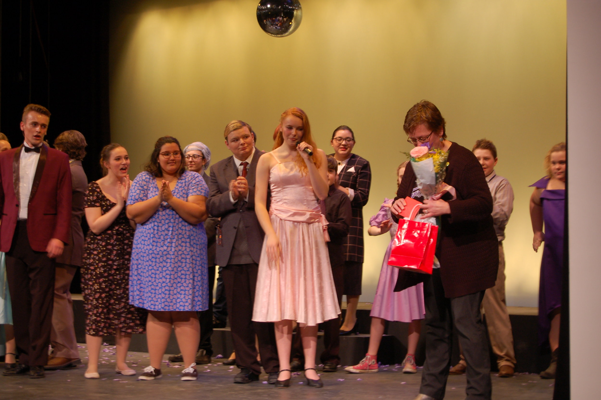 After Sunday's matinee, to send off the show's last performance, members of the cast and crew made special remarks and thanks, giving and accepting cards and flowers. Music director Liz Cordes, far right, accepts a gift from the show's cast and crew.