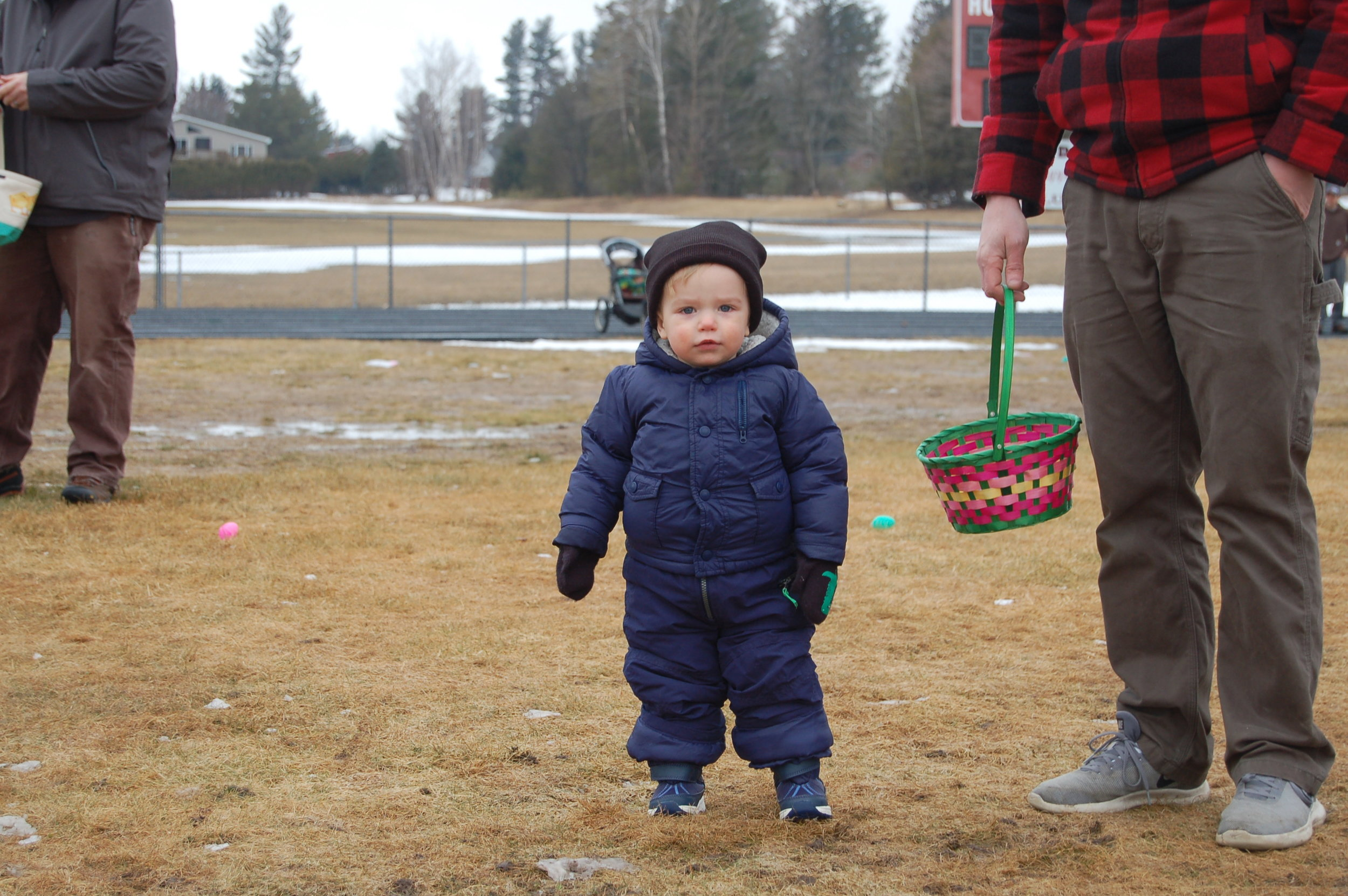Remi McClelland braved the cold in his snow suit that day to participate in his first Erin Farkas Dewyea Easter Egg Hunt.