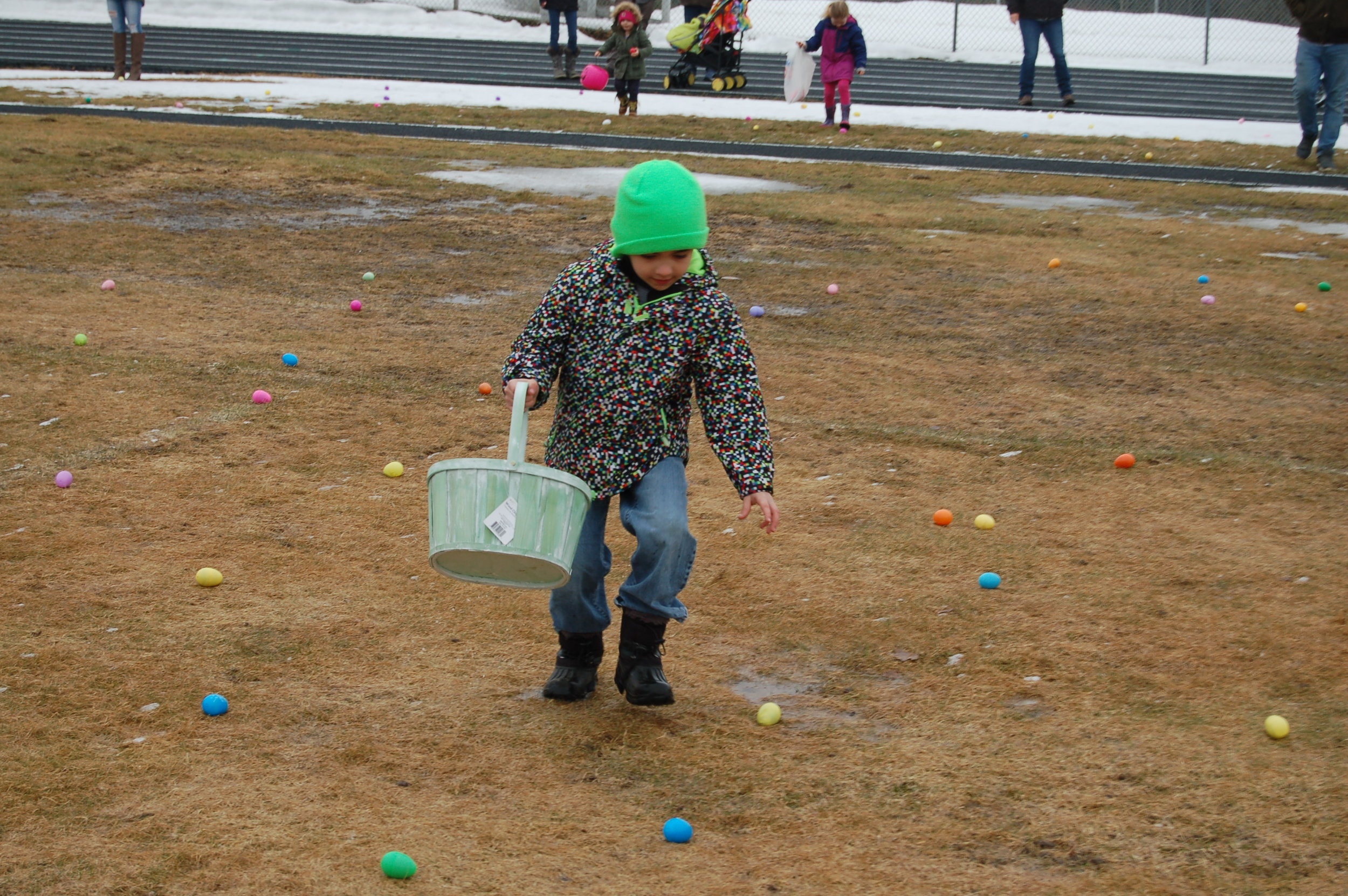 Frankie Tremblay made haste to fill his basket with easter eggs.
