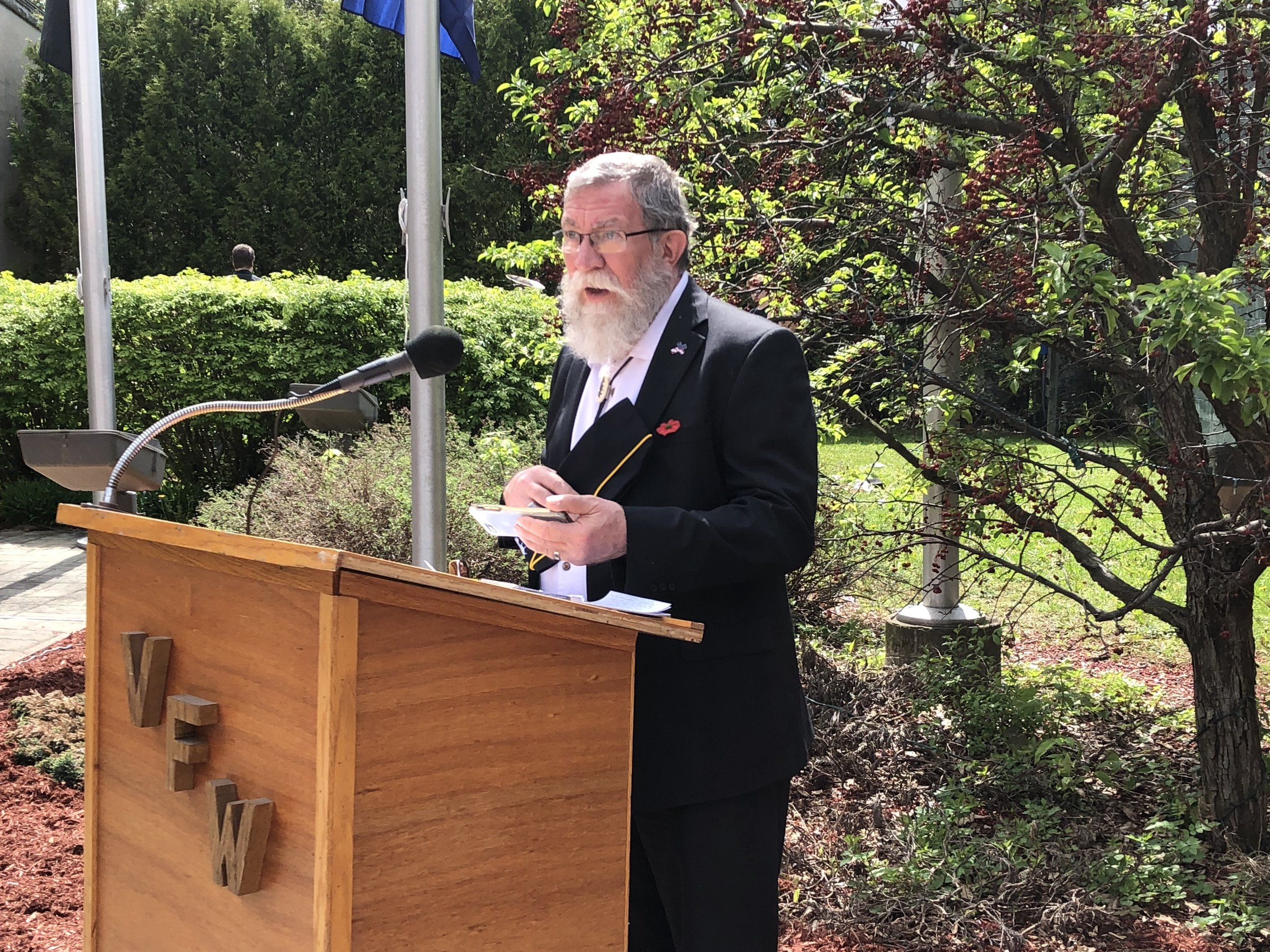 The Reverend Rick Wilburn delivered the opening prayer, asking the Lord's blessing for all those who gave their lives for their country and their families.