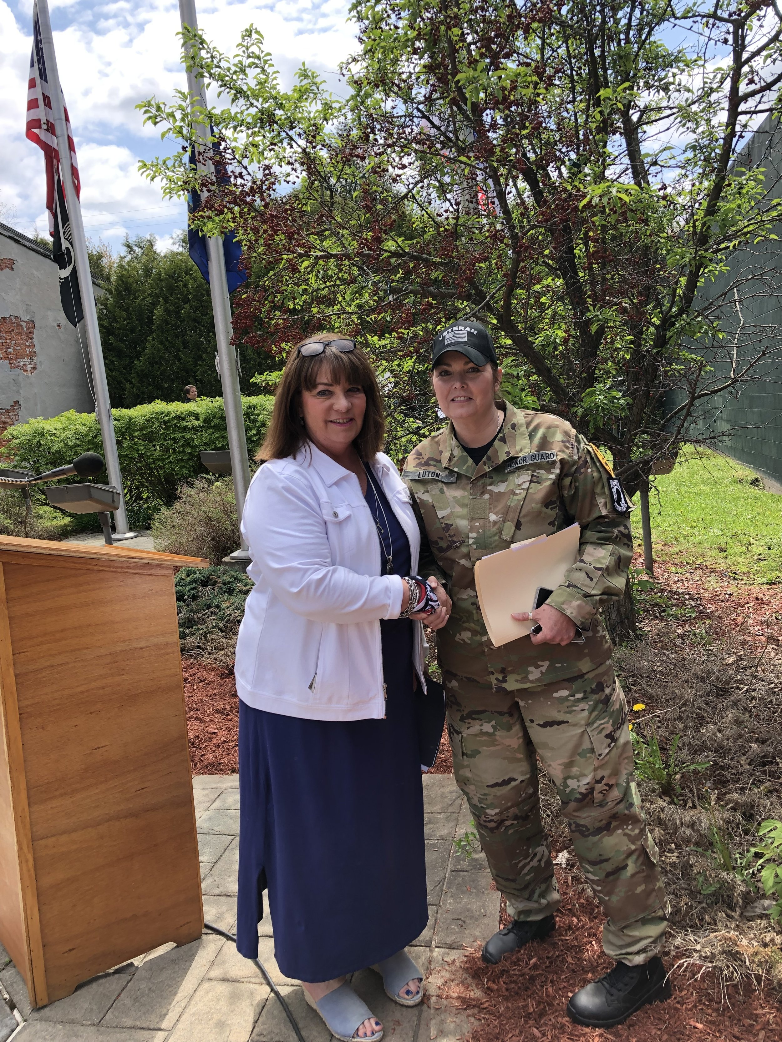 VFW Post Commander Tracy Luton and host of Monday's Memorial Day ceremonies at the veterans' park on Park St. congratulates Guest Speaker and Supervisor Patti Littlefield on a very meaningful address she delivered.