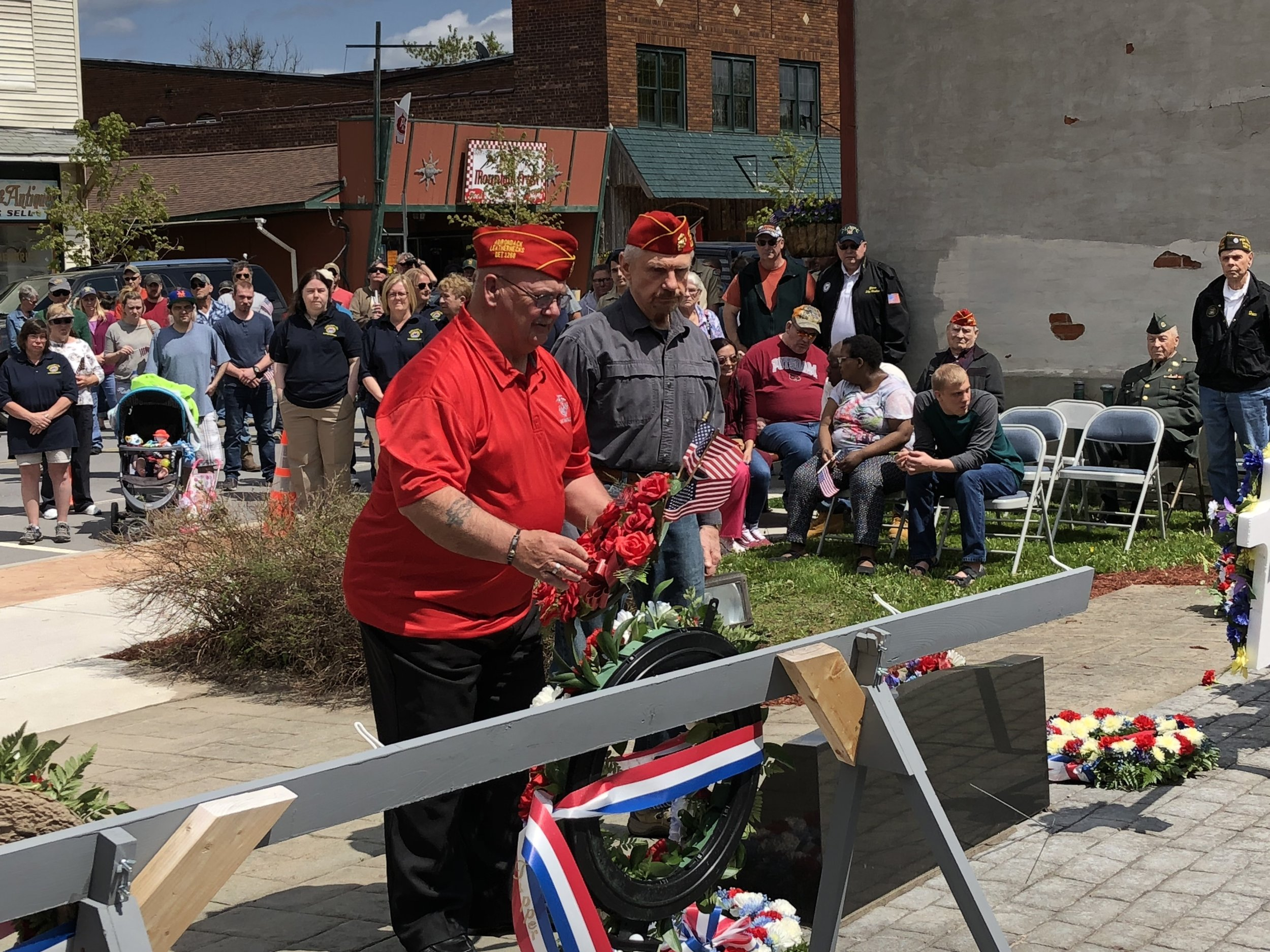 Marine veterans Leon LeBlanc and Craig Bowman presented a wreath on behalf of the Adirondack Leathernecks Marine Corp League Monday.