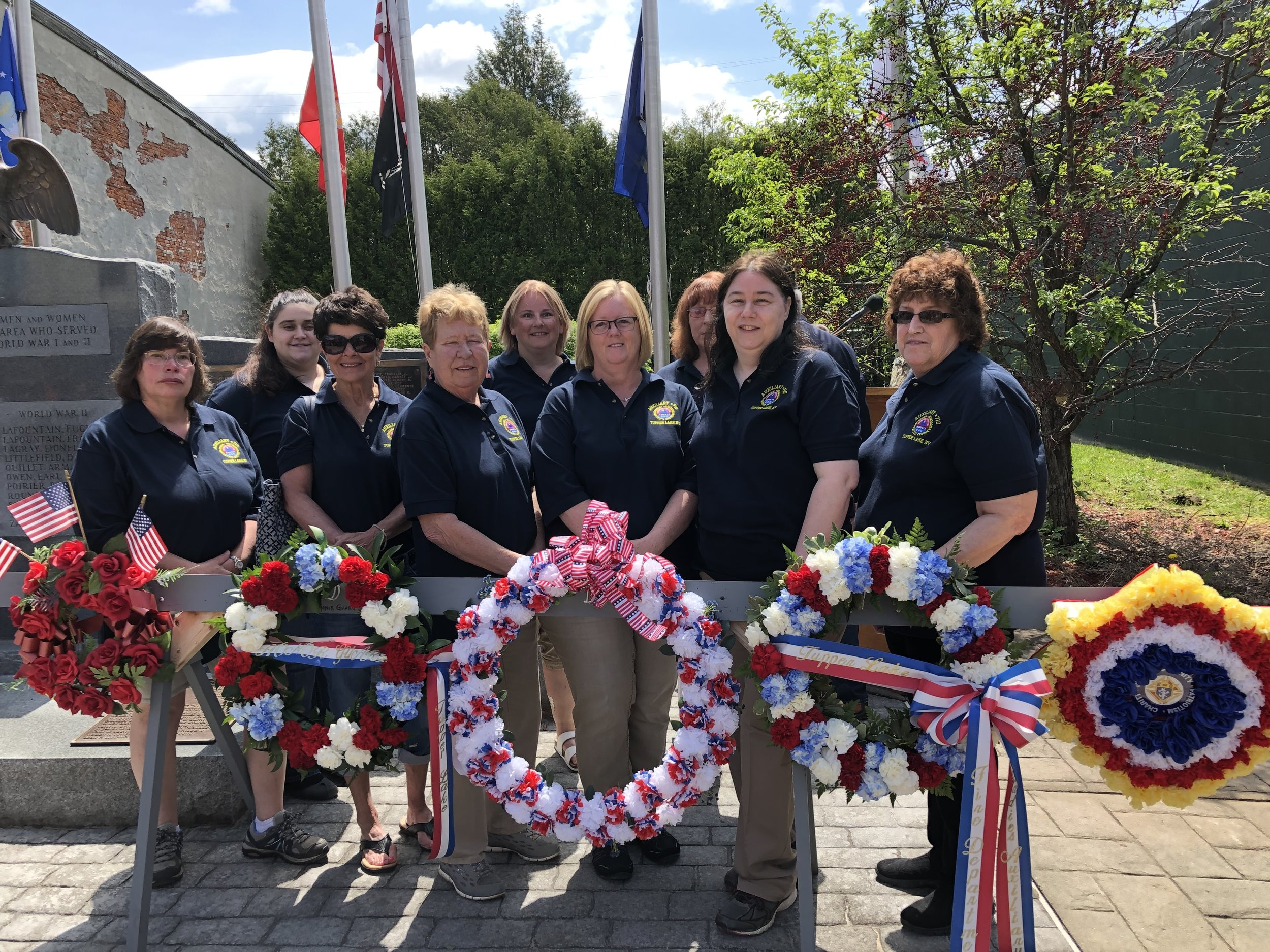 Making their first public appearance in their new uniforms at Monday's Memorial Day ceremonies were members of the Amvets Post 710 Ladies Auxiliary. From left behind their wreath were Cindy Hoyt, Celeste Amell, Fran Smith, Diane Buntich, Vicki Dukette, Lisa Reed, Lorri Neumann, Phyllis Larabie and Patty McMahon.