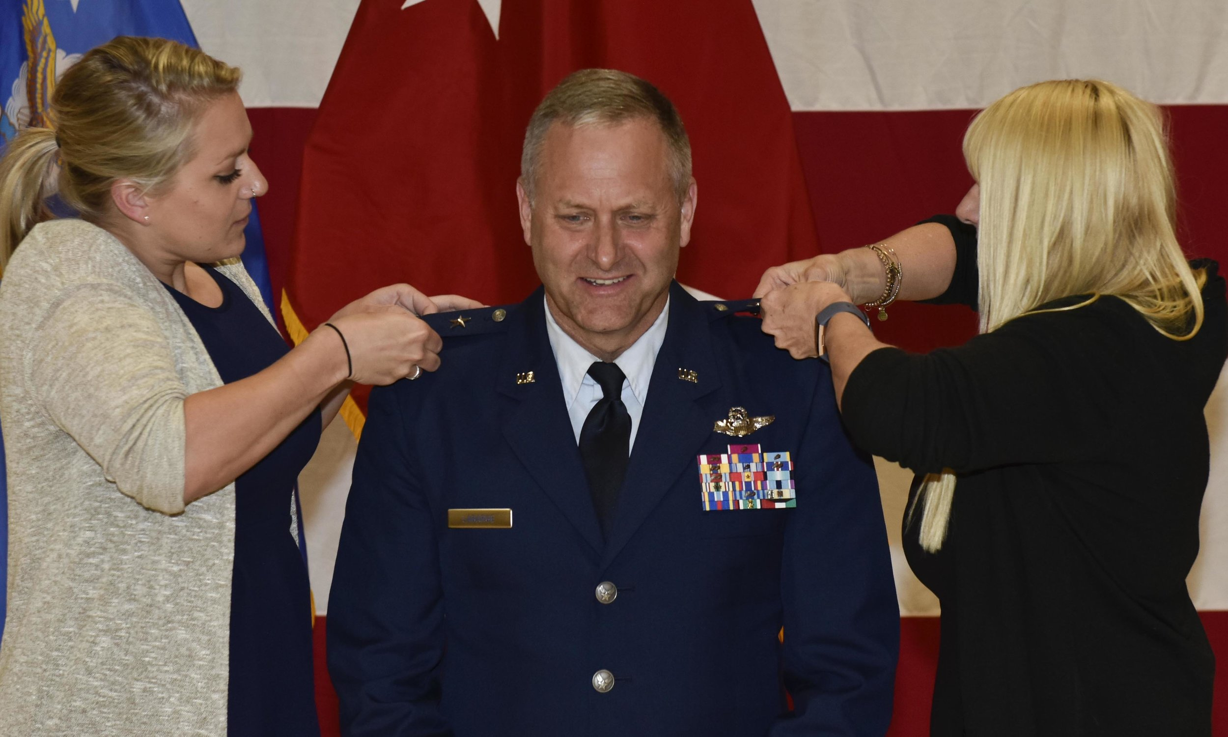 New York Air National Guard Major General Timothy LaBarge, the commander of the New York Air National Guard and a Tupper Lake resident, receives his second star from his daughter Emily (left) and his wife Petra, during promotion ceremonies held on June 1, 2019 at New York National Guard Headquarters in Latham, N.Y. LaBarge and Major General Thomas Owens, Air National Guard Assistant to the commander of Air Force Global Strike Command, were promoted to Major General rank in a dual ceremony by Major General Ray Shields, the Adjutant General of New York (U.S. Air National Guard photo by Staff Sgt. Ben German)