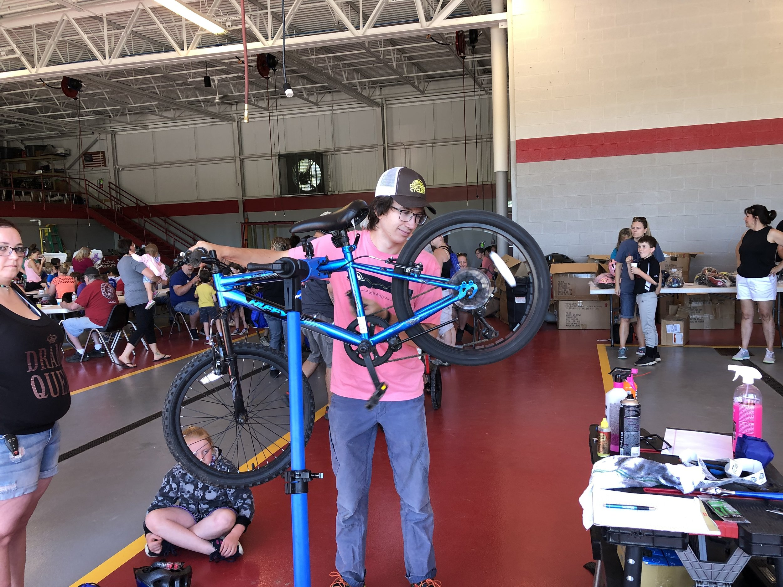 Ben Thompson of High Peaks Cyclery was one of two technicians provided by the Lake Placid-based bike shop to do adjustments and tune-ups for any of the young riders who asked at Saturday's very successful Bike Rodeo and Celebration of Youth.