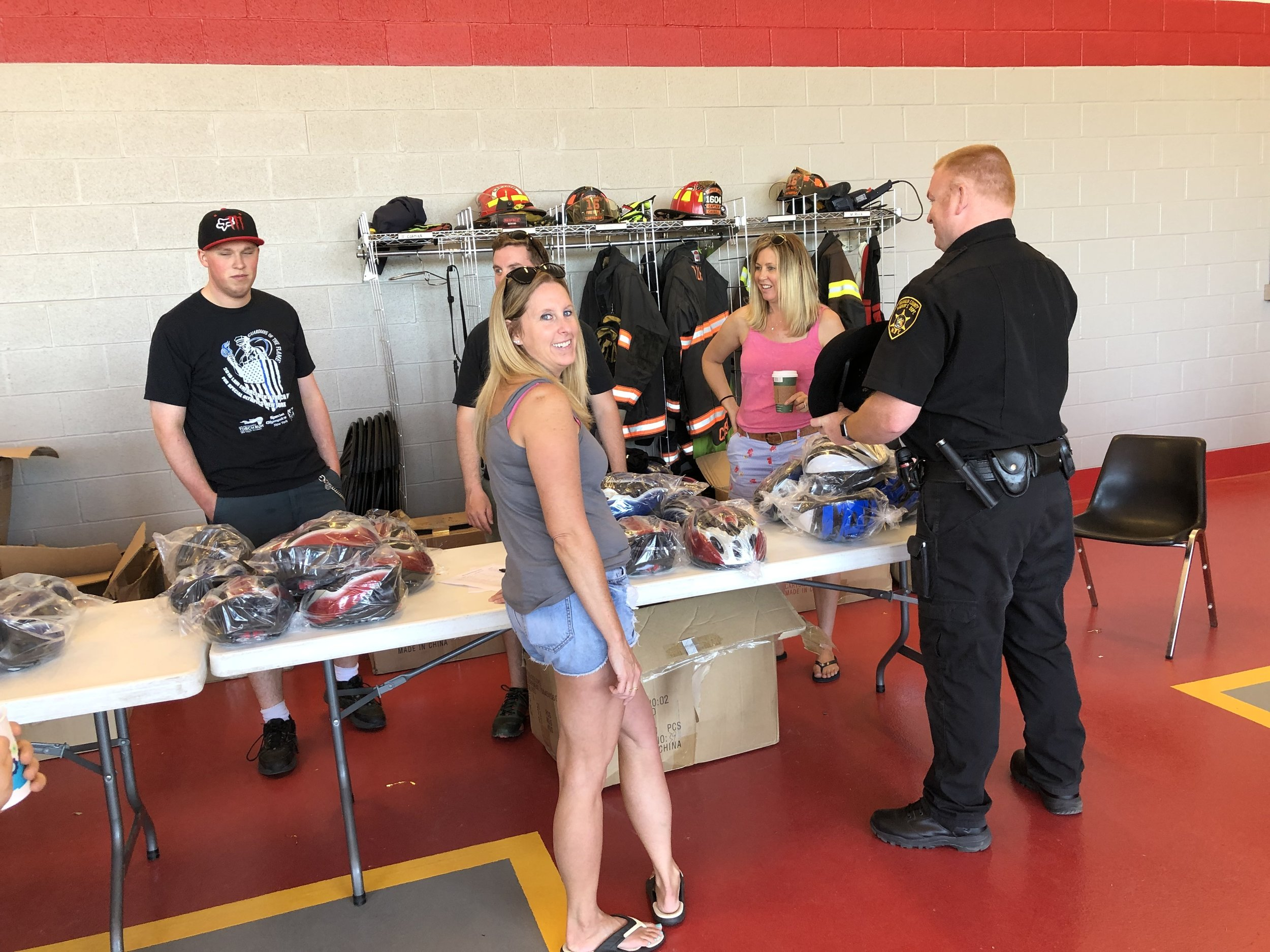 Kiwanis Club members, who each year help Mike Vaillancourt orchestrate his big June event, stayed busy Saturday giving out free helmets to any child who needed one, as part of the police department's commitment to keep kids safe.