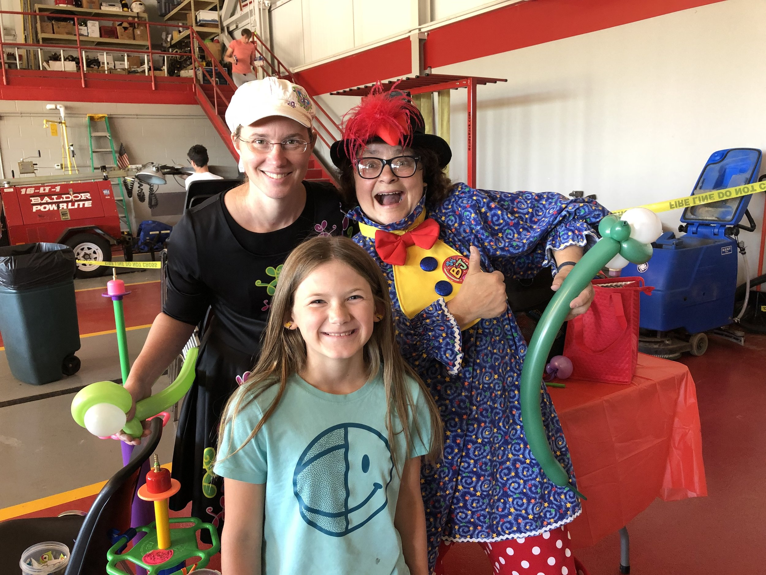 Flutterbug the Clown, a skilled face painter and entertainer, was joined this year by a new clown, BJ. With them Saturday at their booth inside the fire station was their new friend Pailin Hample, who served up a great smile for the Free Press photographer.