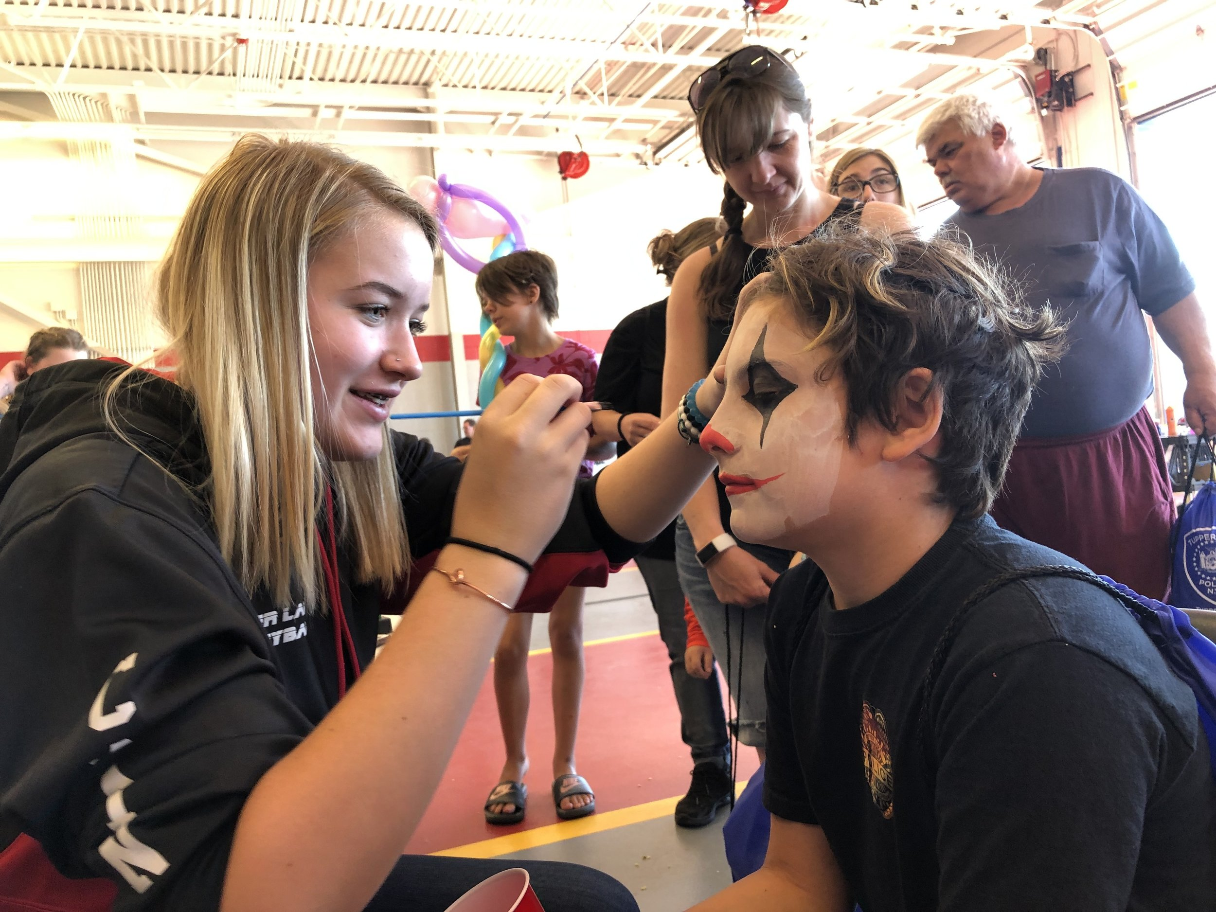 Inside the fire station Saturday were over a dozen booths where children could get free things, including face painting. In the photo Tanner Varden was getting his face decorated by Elaina Daniels.