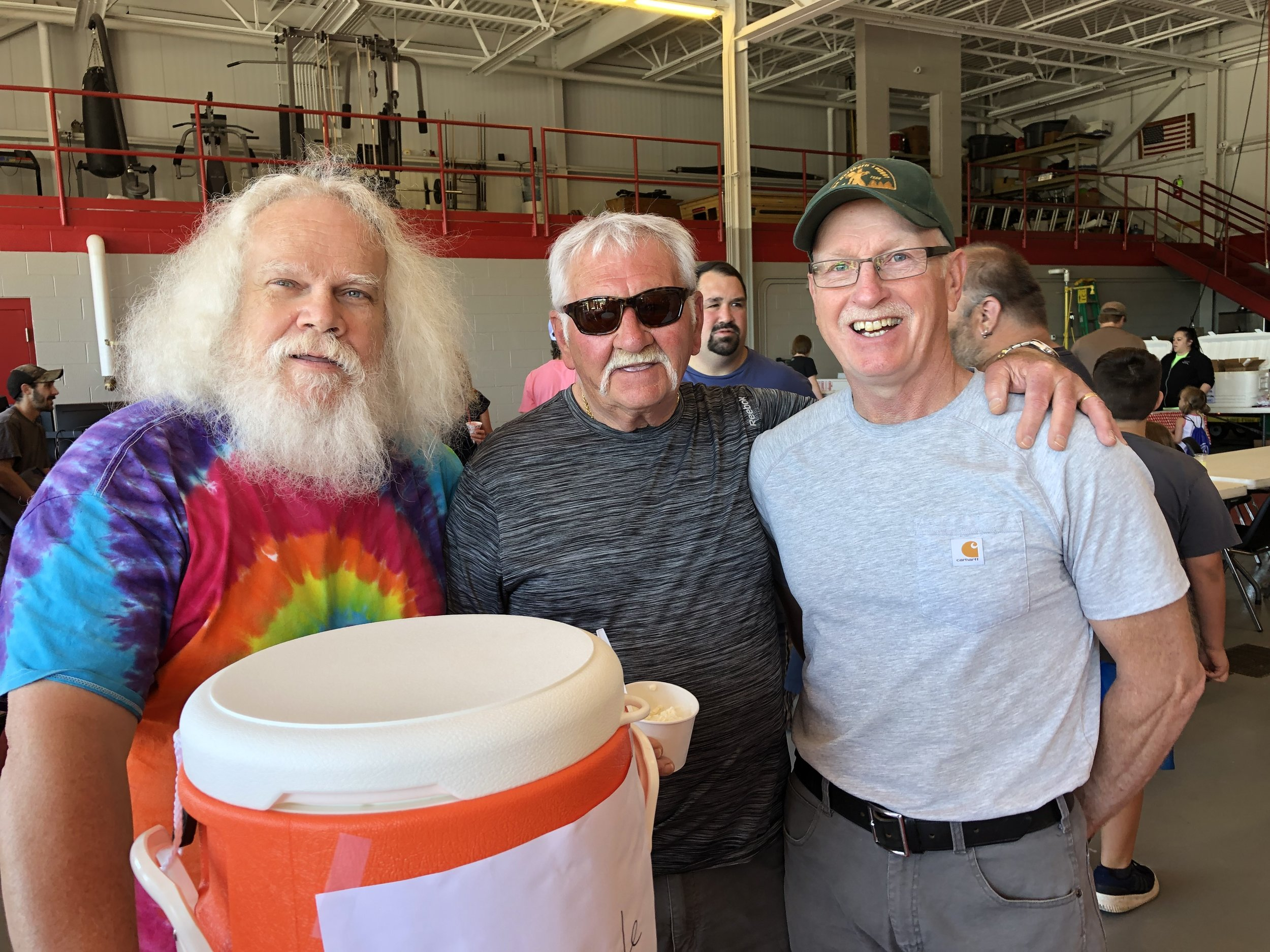 Veteran fireman Mike Russell was serving sweet drinks from two vats Saturday at the bike rodeo and at one point was joined by a couple happy rodeo-goers, Mike Arsenault and Jeff Thomas.