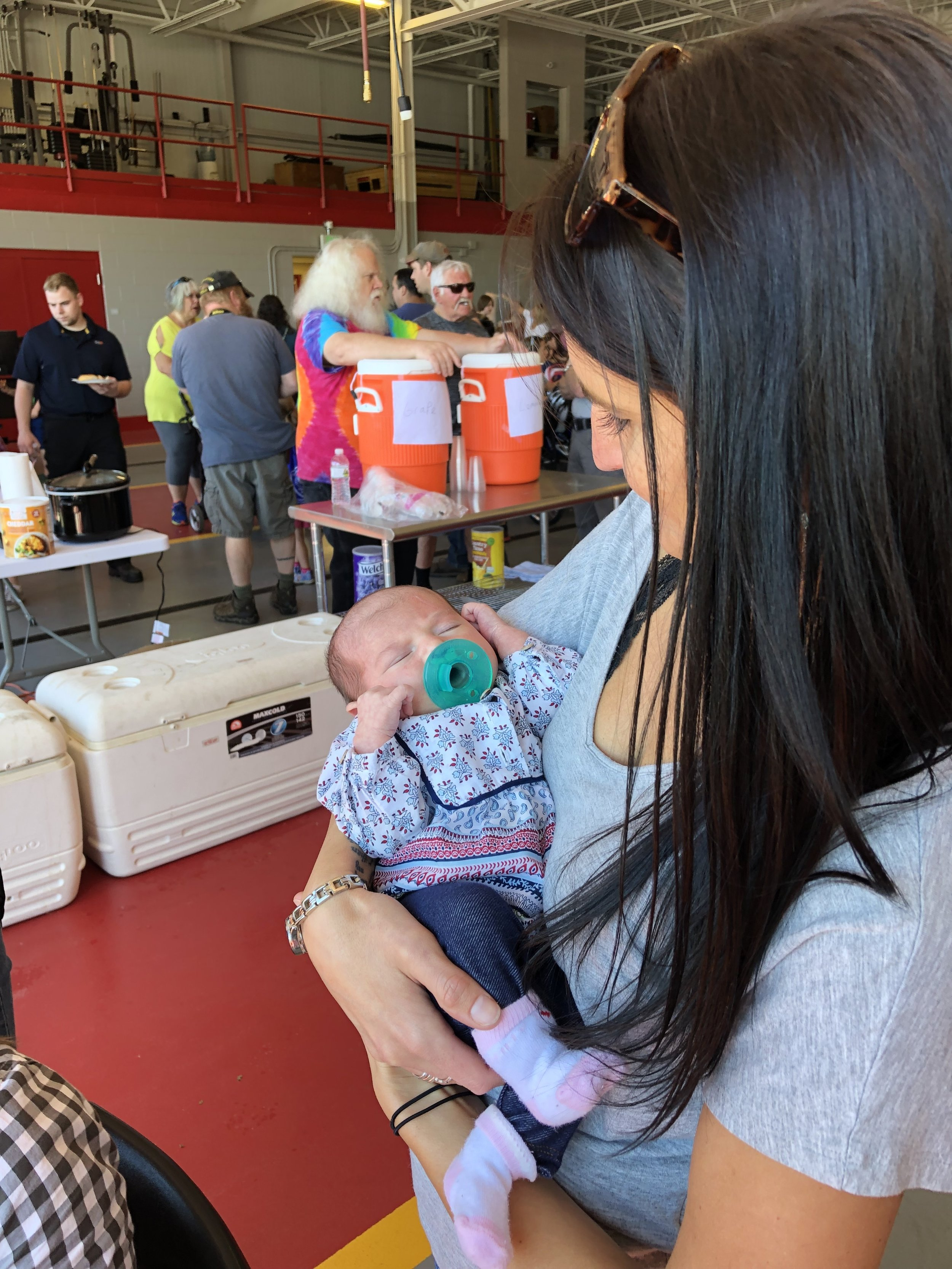 The youngest participant at the 13th annual Bike Rodeo Saturday was week old Kinsley Cole, newborn of Jessica and Royce. Holding the tiny lass was friend Kristin Pelkey.