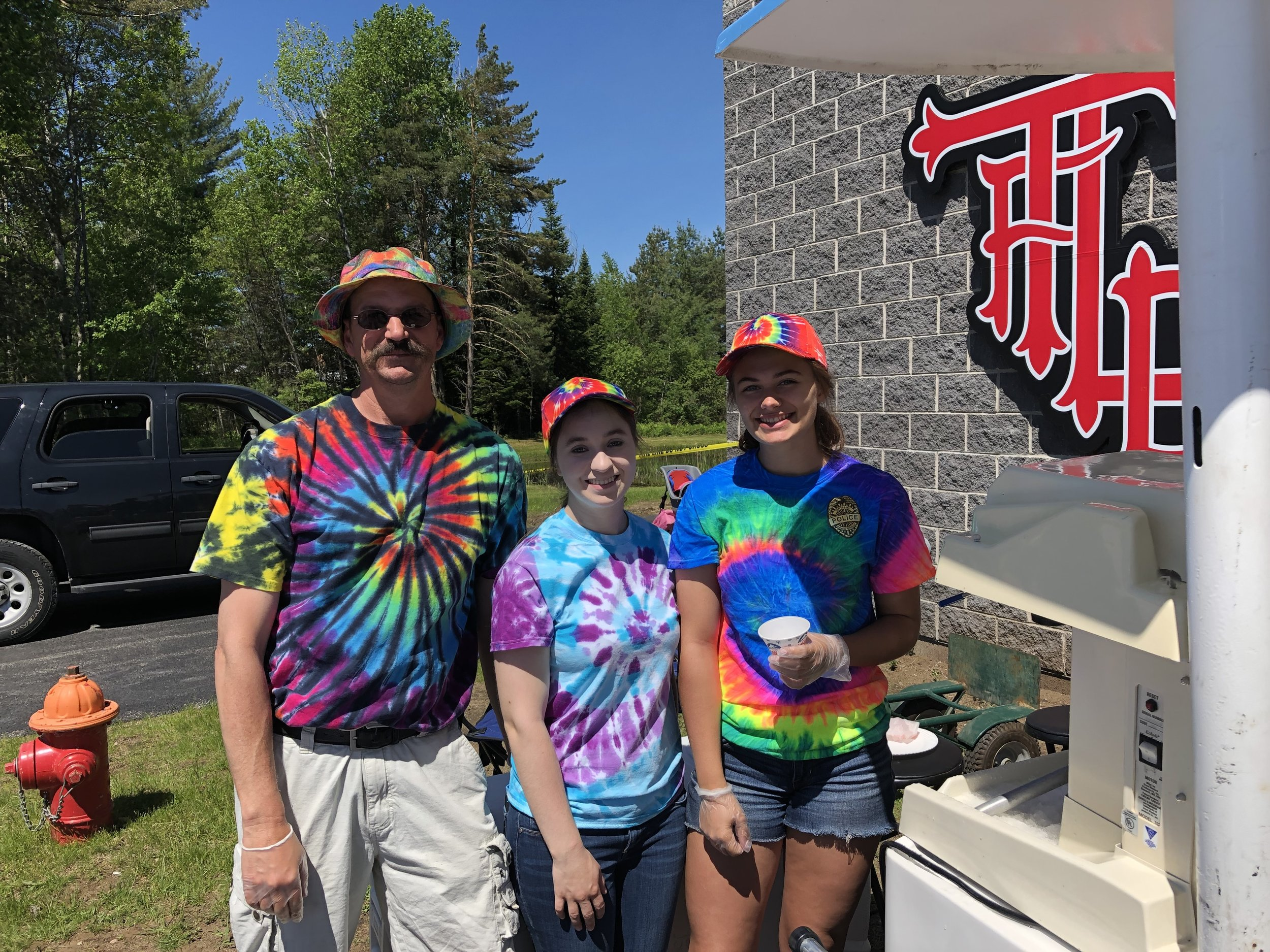 Carl Larson and his snow cone team Lindsay Remington and Rylie Fletcher kept their cool product flowing for thirsty bike riders. Over 375 cones they served.