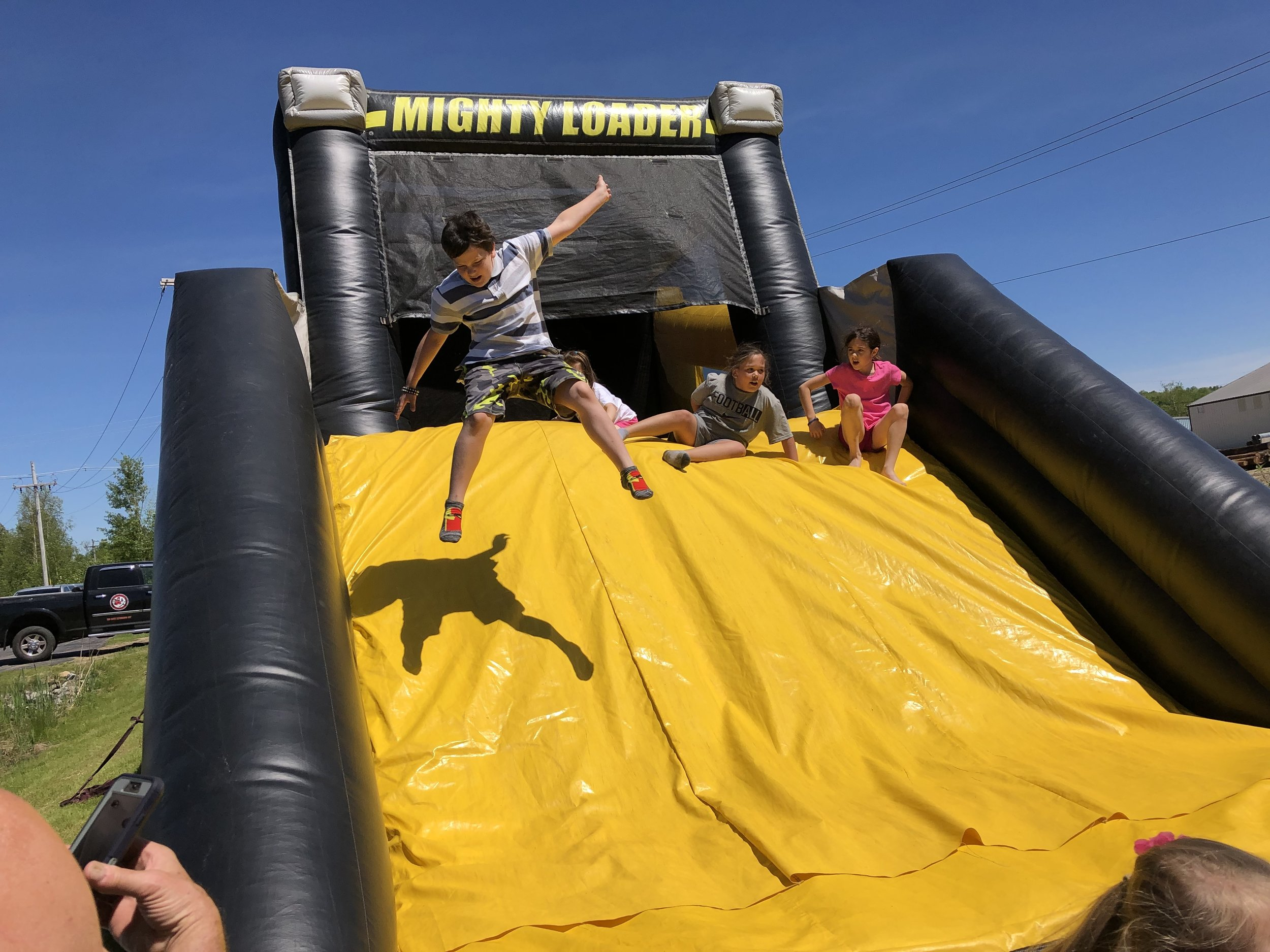 When kids at Saturday's annual Tupper Lake Police Department Bike Rodeo and Celebration of Youth weren't eating or riding their bikes in various road courses, they were probably bouncing, sliding and jumping on three large inflatable attractions constructed on the grounds of the Emergency Services Building, as these photos showed.