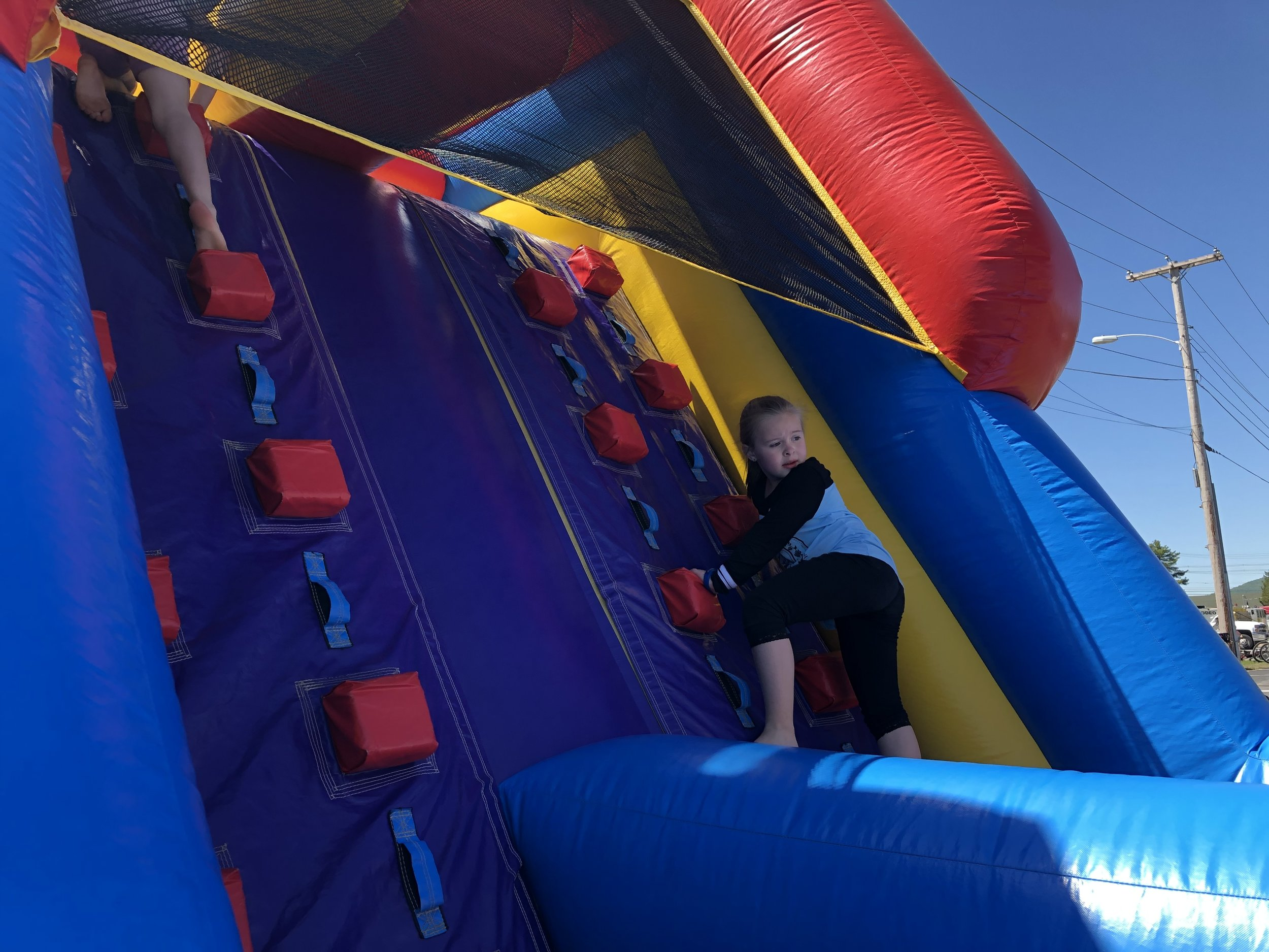 Fright was on the face of this young climber in the new obstacle course at the bike rodeo.