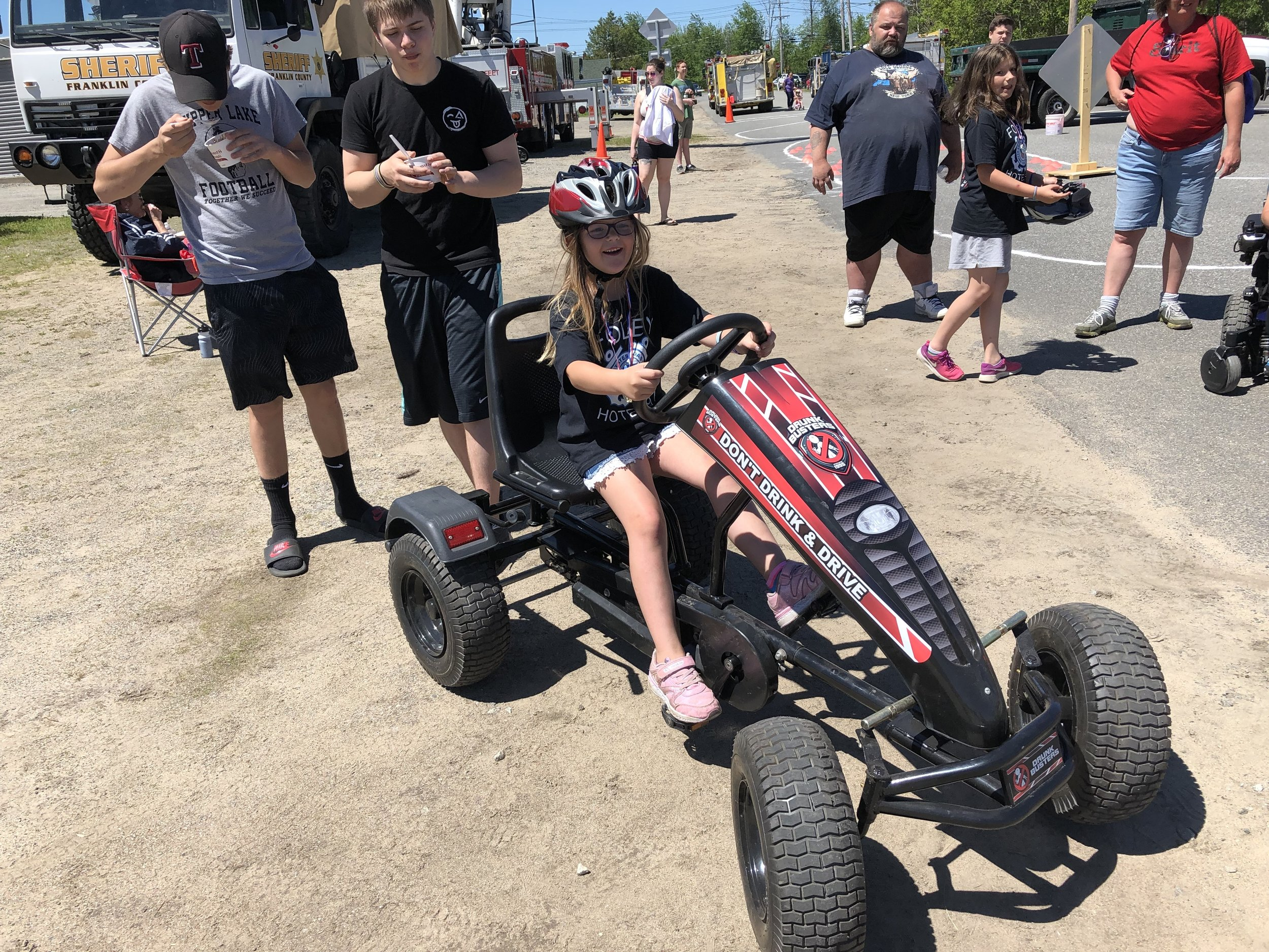 Arianna McLear was just about to don the beer goggles to pilot the motorized rig again brought to the Tupper Lake bike rodeo Saturday by the county's STOP-DWI program. The goggles simulate what it is like to operate a vehicle while under the influence of alcohol.