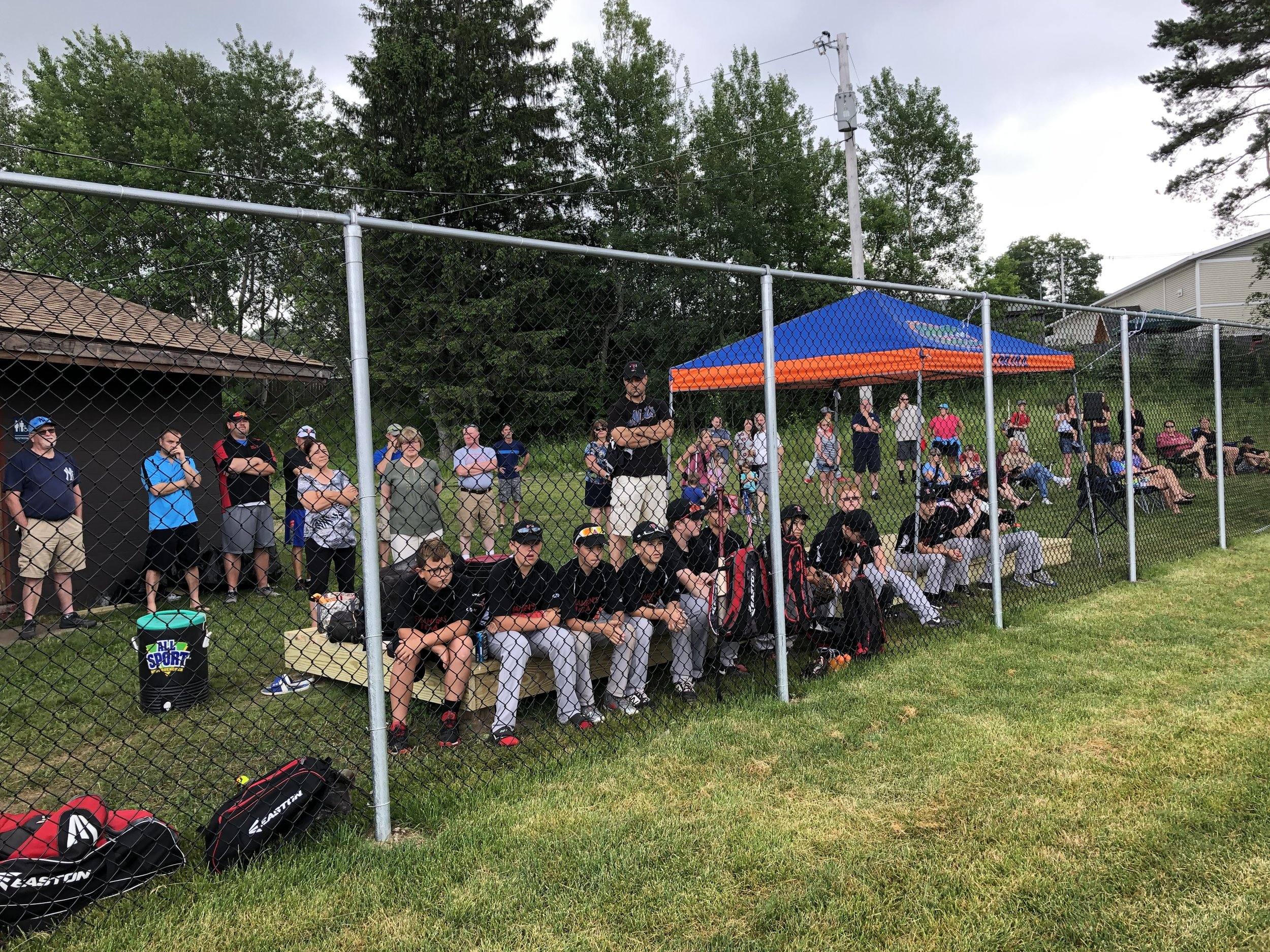 Tupper Lake baseball players listen to the opening ceremonies Saturday before the ribbon-cutting of the new field adjacent to the Little Logger Playground in the municipal park.