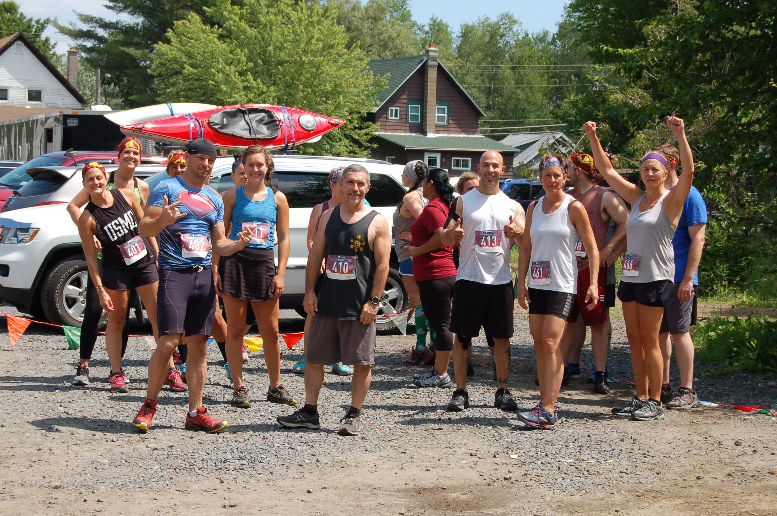 Amy Ambrose, Randy Beckwith, Sarah Ford, Rich Edwards, Stephen Galetta, Gayle Roy-Collin, Elizabeth Vicencio and other runners of the race's first wave wait for their cue to start which was at noon sharp.
