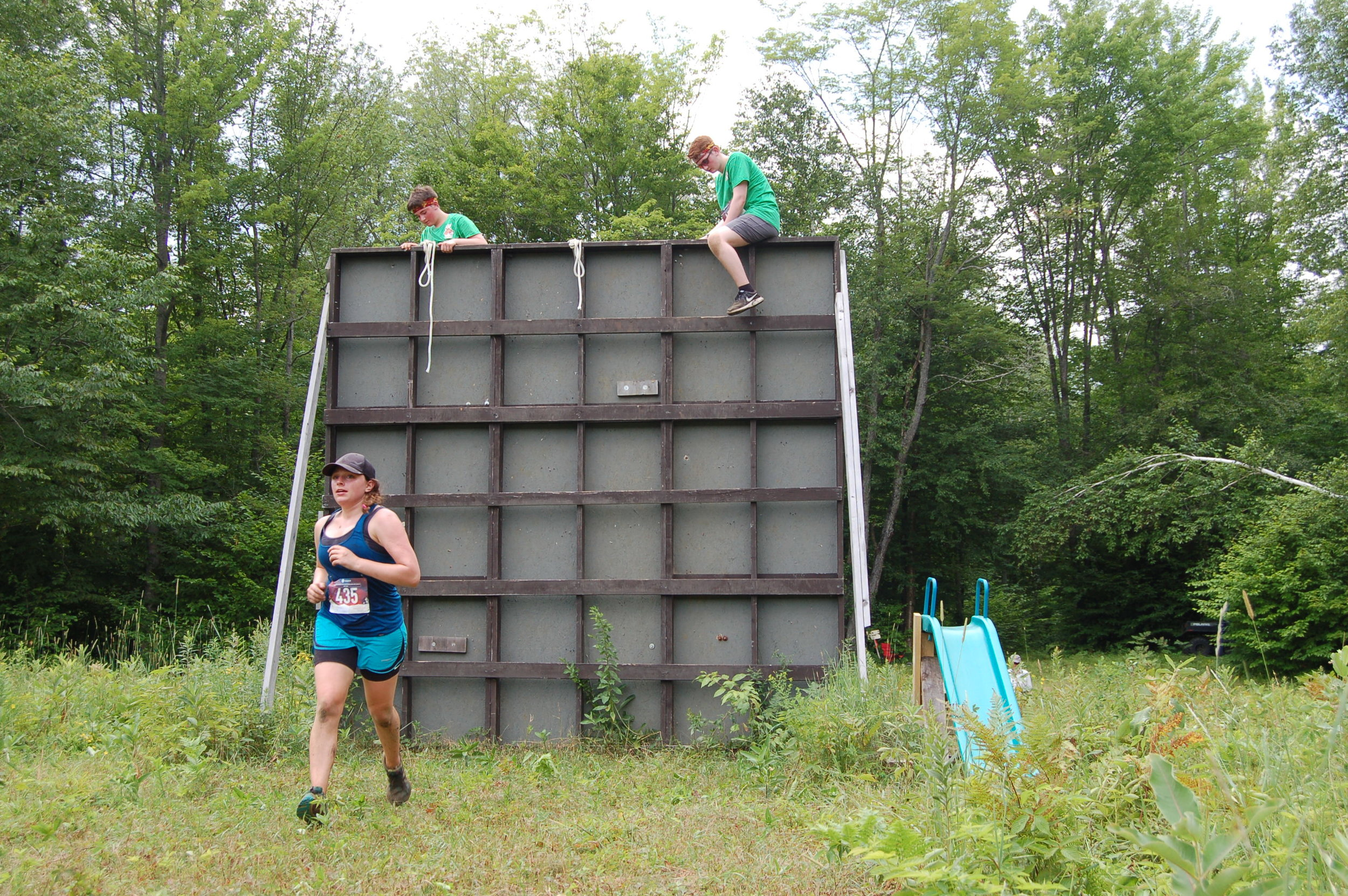 Tupper Lake's own Bridget O'Leary moves onto the next obstacles after conquering the rope wall. Zachary Mueller and Chase Rice Porter with Zachary Mueller and Chase Rice Porter of Black River just getting over.