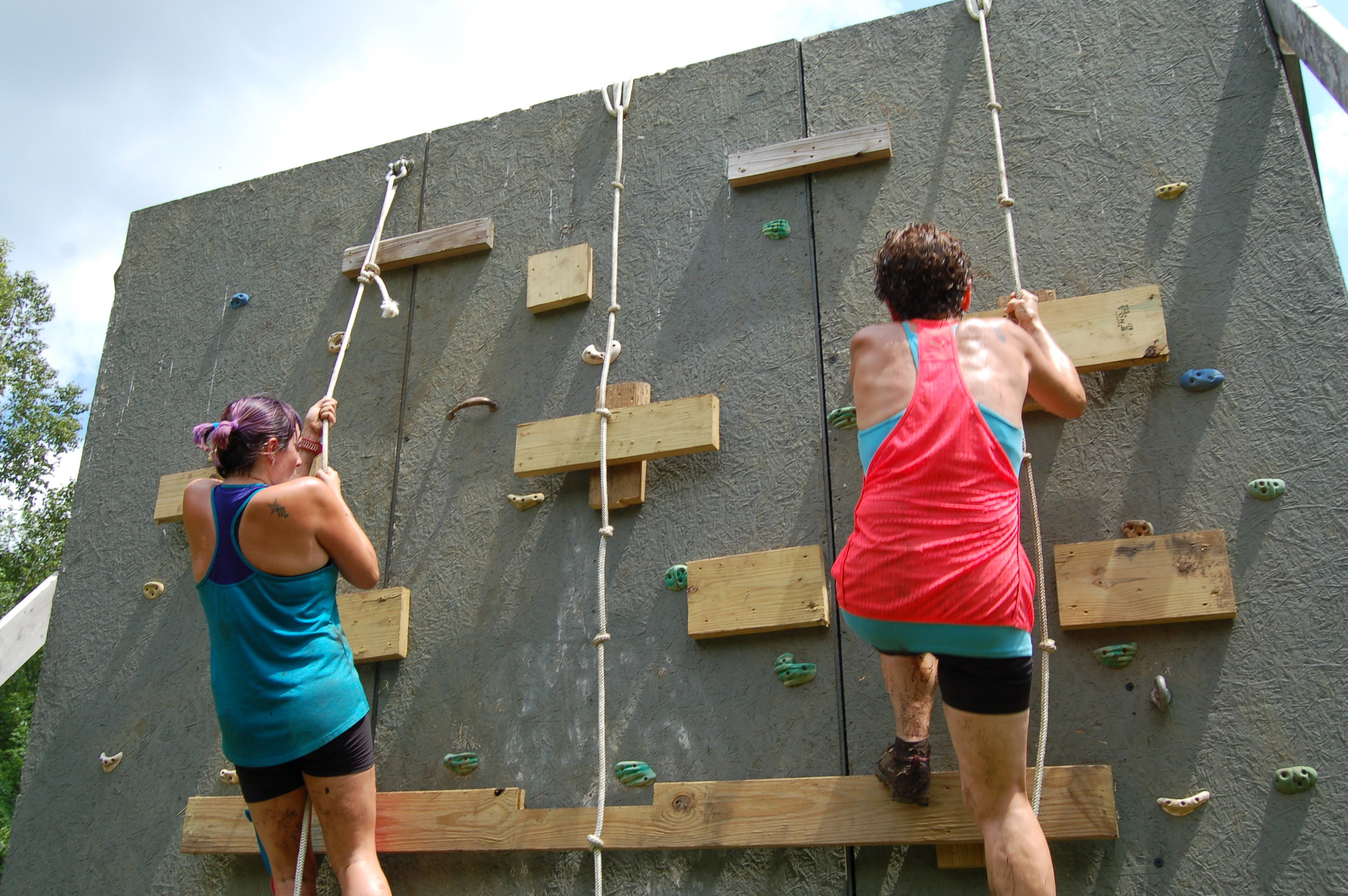 Mother-daughter duo, Erica and Brenda Preston of Canton tackle the rope wall.