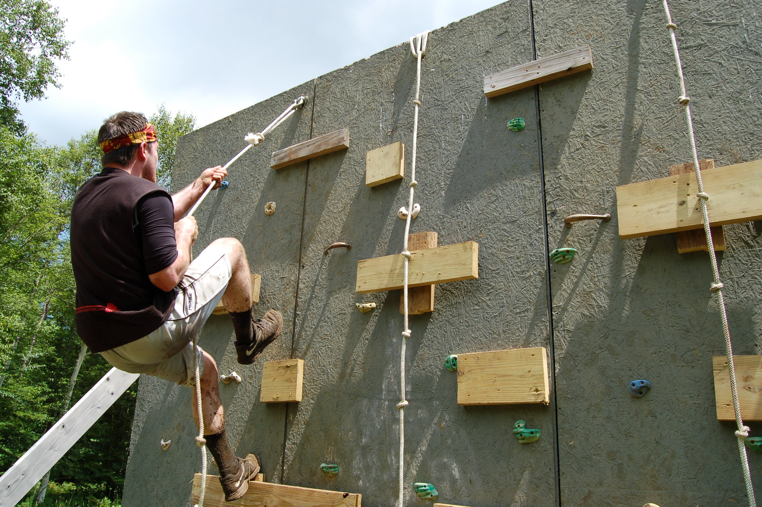 Benjamin Landor of Cohoes climbing swiftly up and over the rope wall.